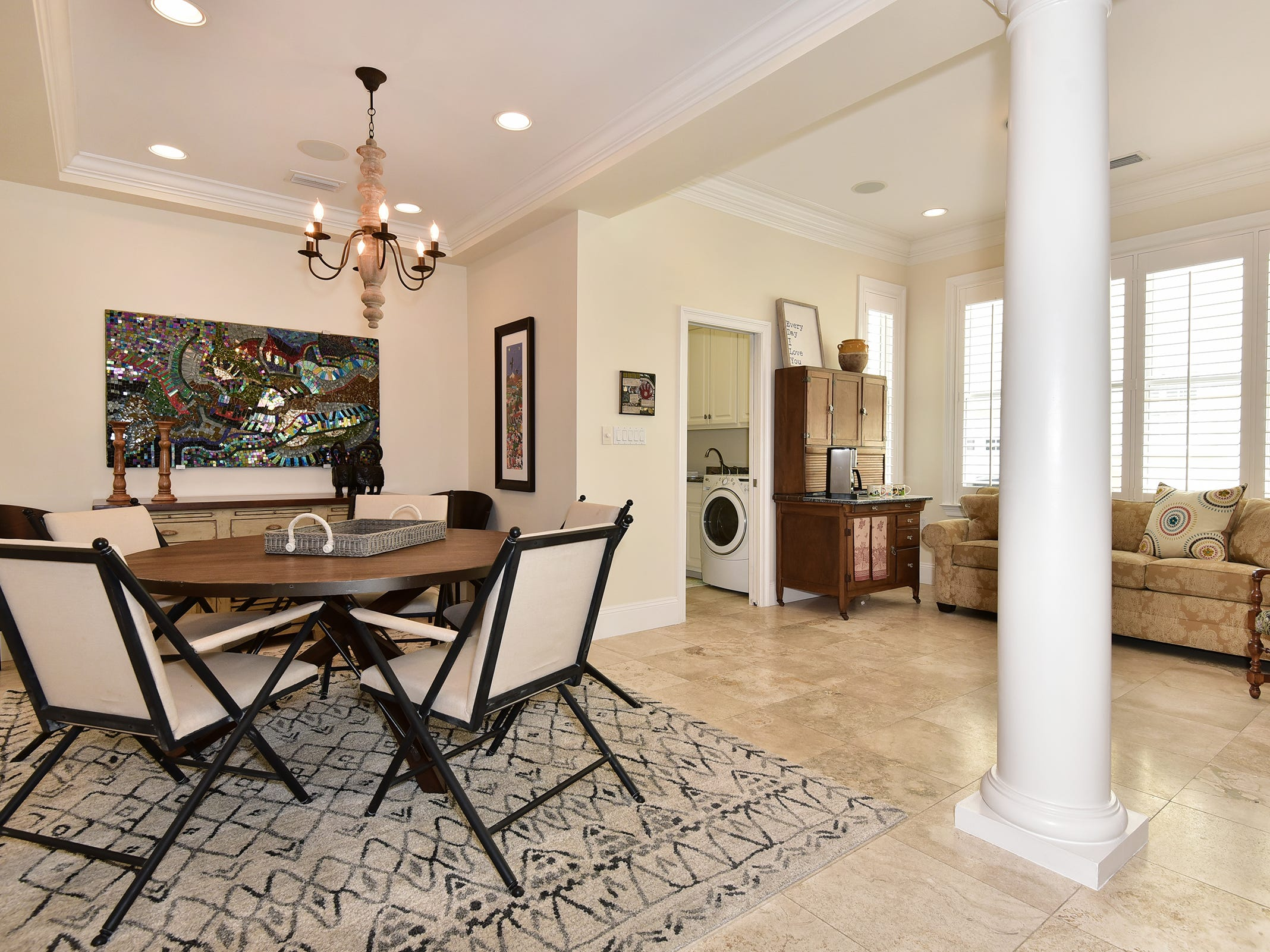 52 Port Royal Way, the formal dining space is open to the living area.