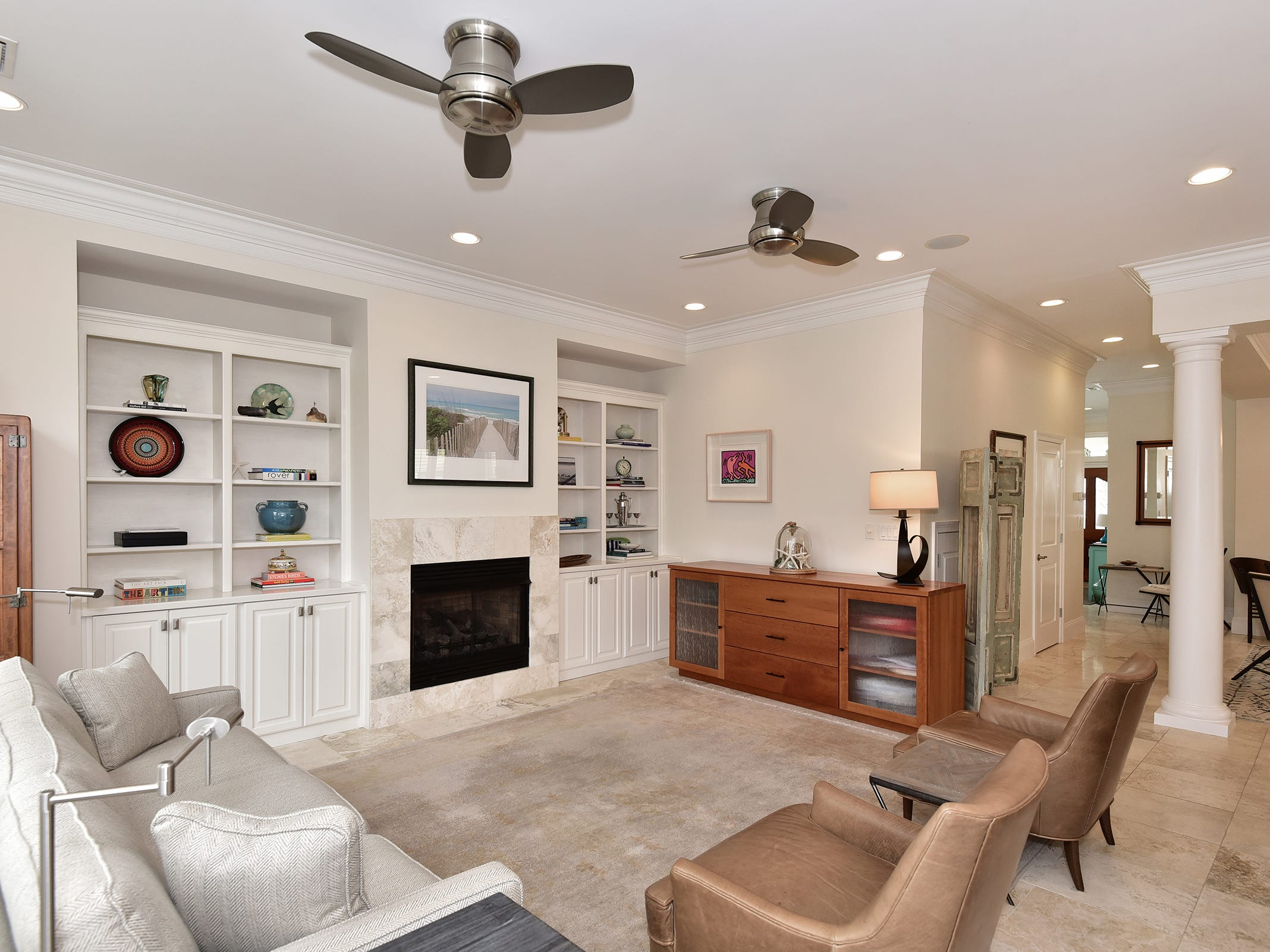 52 Port Royal Way, the light and bright livine area with a fireplace.