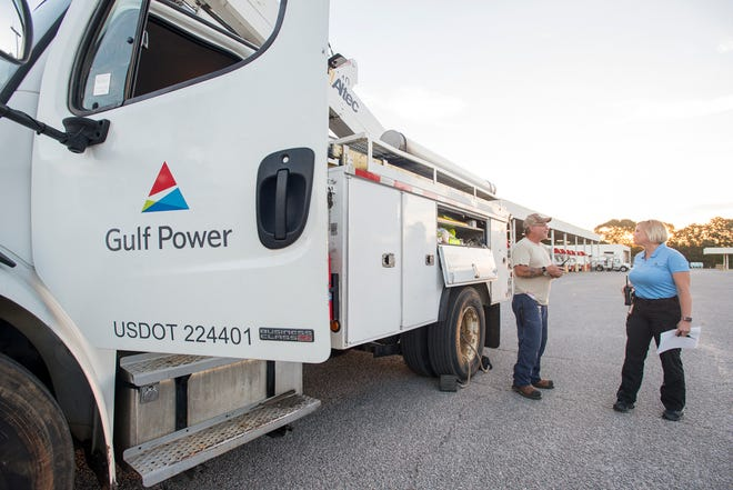 Gulf Power service tech Vance Currier, left, talks with security officer Tabitha MGhee before they head north out of Pensacola on their way to the Carolinas in preparation for the approaching Hurricane Florence on Thursday, September 13, 2018.