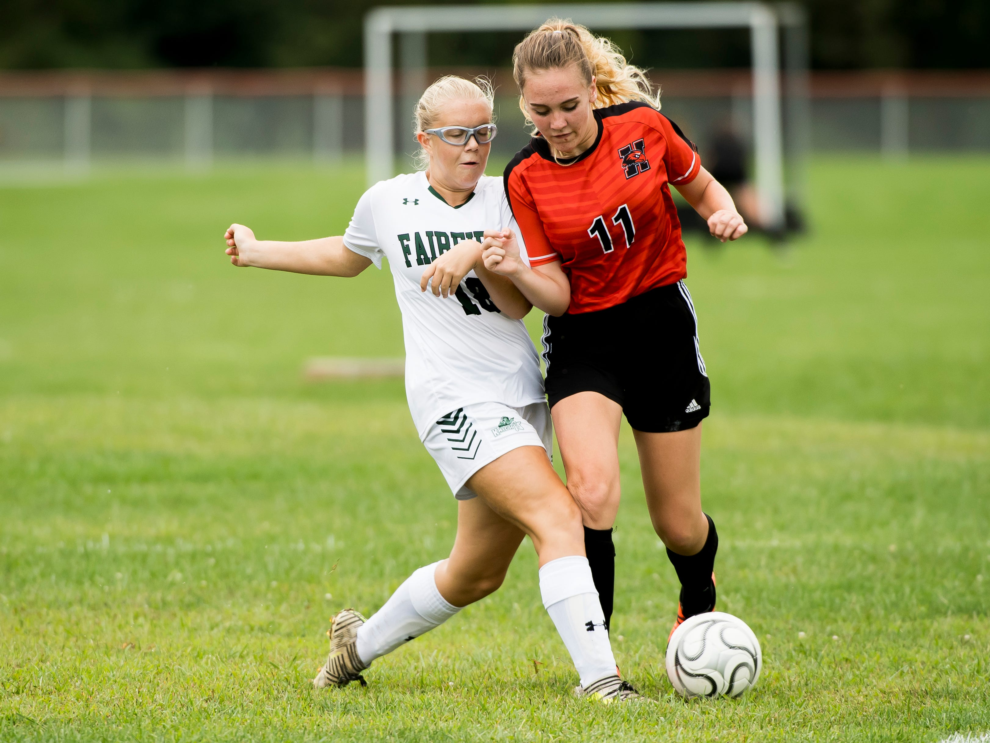 Hanover's Olivia Topper (11) battles for possession with Fairfield's Amelia Michaels during a game on Thursday, September 13, 2018. The Knights beat the Nighthawks 19-0.