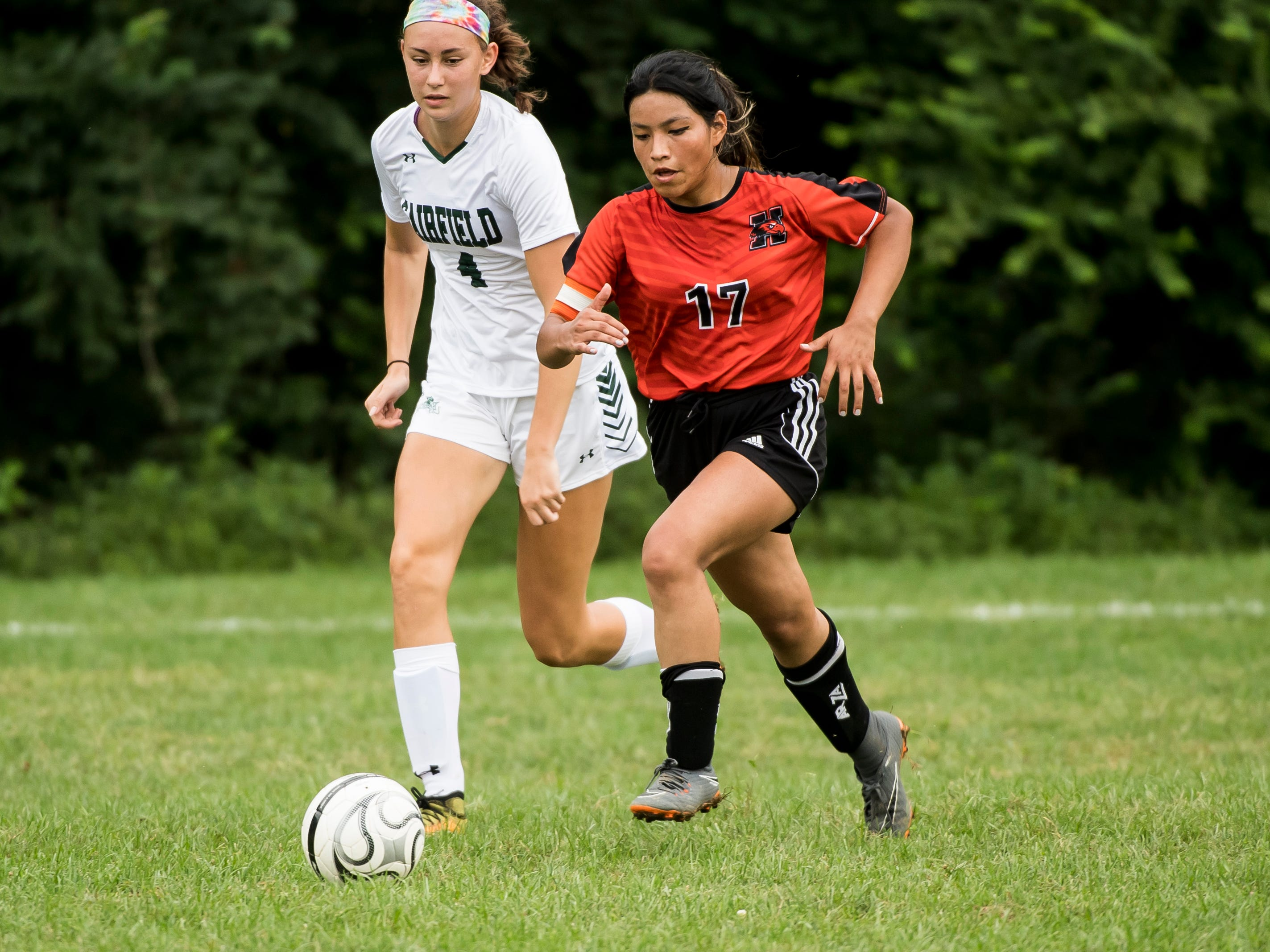 Hanover's Lourdes Ibanez (17) moves the ball down the field as Fairfield's Kendra Miller gives chase on Thursday, September 13, 2018.