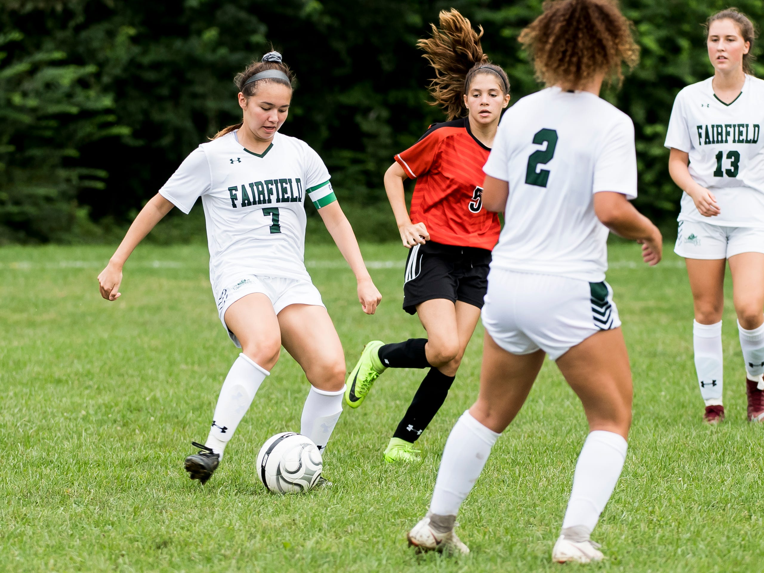 Fairfield's Maya Callenbach (7) looks to pass the ball during play against Hanover on Thursday, September 13, 2018.