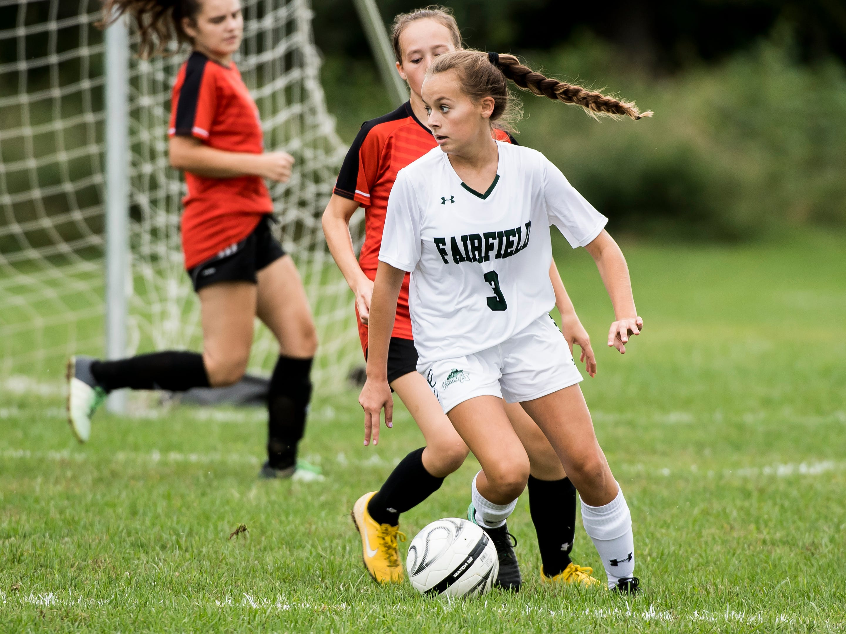 Fairfield's Emma Dennison dribbles the ball down the field during play against Hanover on Thursday, September 13, 2018. The Knights beat the Nighthawks 19-0.