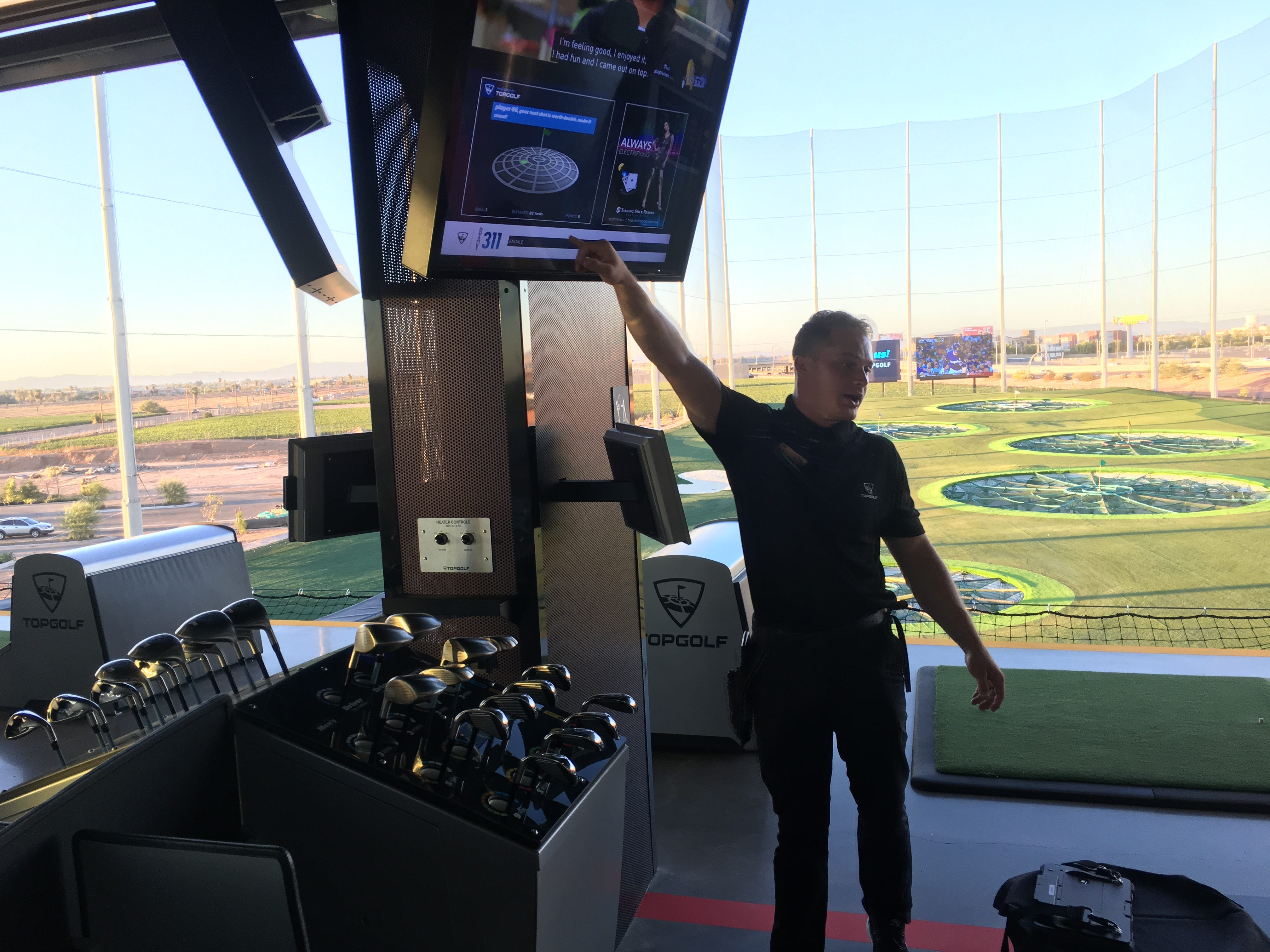Topgolf event ambassador Lucas Lourie explains the game and how scoring works to a group during a tour Sept. 12, 2018, of Topgolf's newest Valley location in Glendale. It's scheduled to open in September.