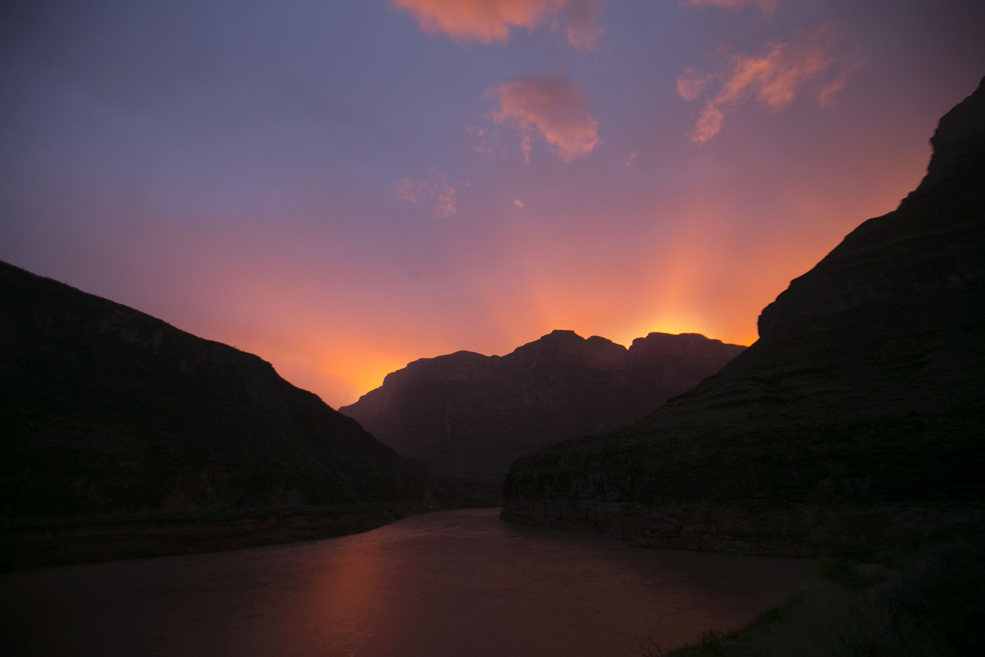 The sun sets over the Colorado River in the western part of Grand Canyon National Park.