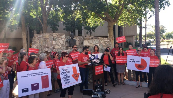 The Arizona Education Association hosting a press conference outside of the Arizona State Capital building.