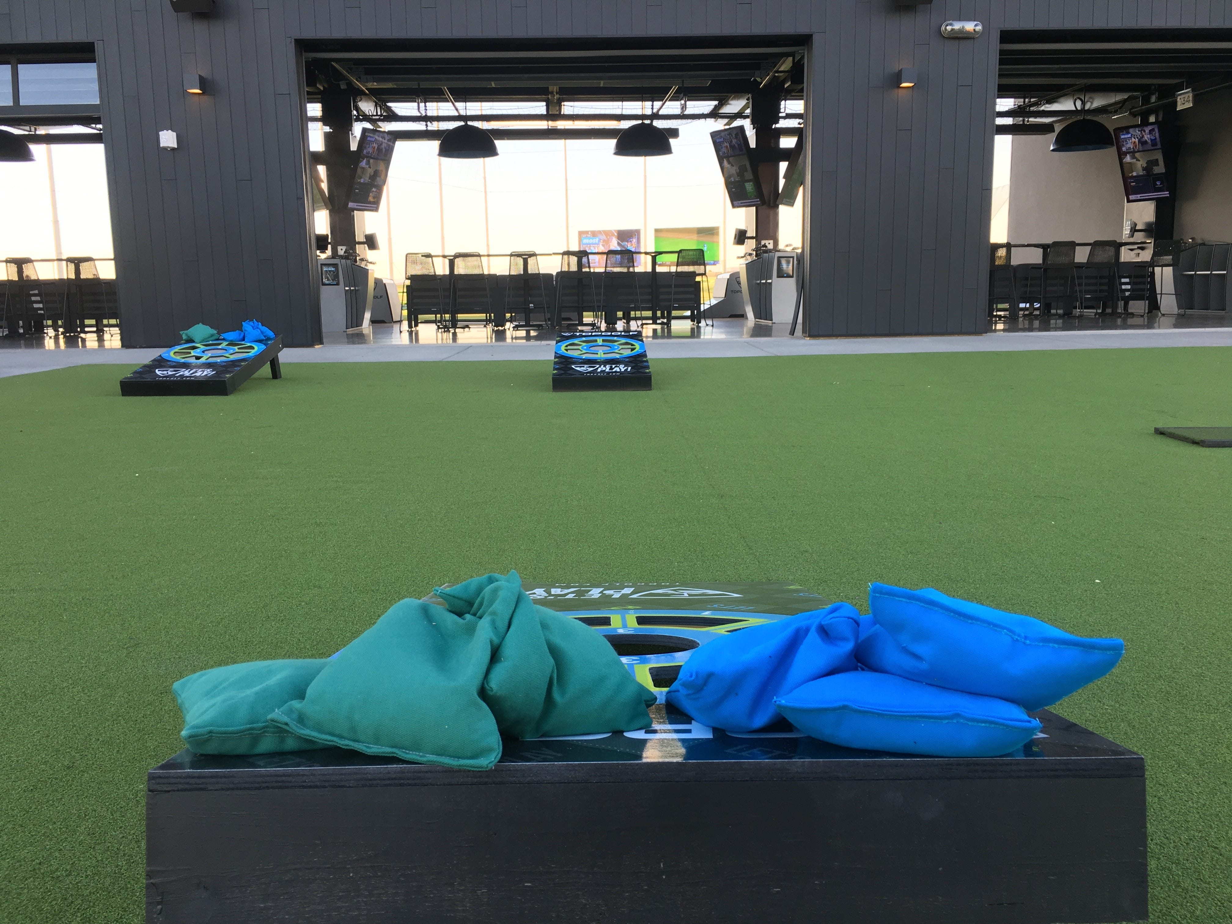 Topgolf Glendale's outdoor patio on the first floor features an area for cornhole and is unique to the West Valley location.