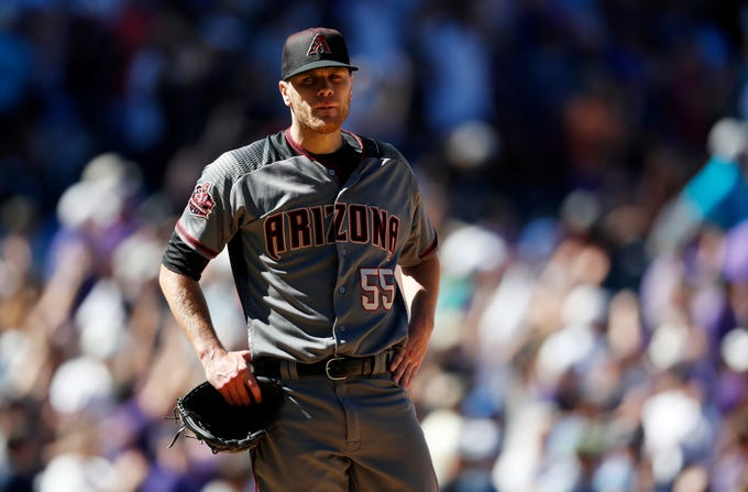 Arizona Diamondbacks starting pitcher Matt Koch reacts after giving up a two-run home run to Colorado Rockies' Trevor Story in the third inning of a baseball game Thursday, Sept. 13, 2018, in Denver. (AP Photo/David Zalubowski)