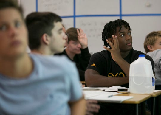 Israel Benjamin, a 17-year-old junior and running back for the Saguaro Sabercats at Saguaro High School in Scottsdale on Mon. Aug. 20, 2018.