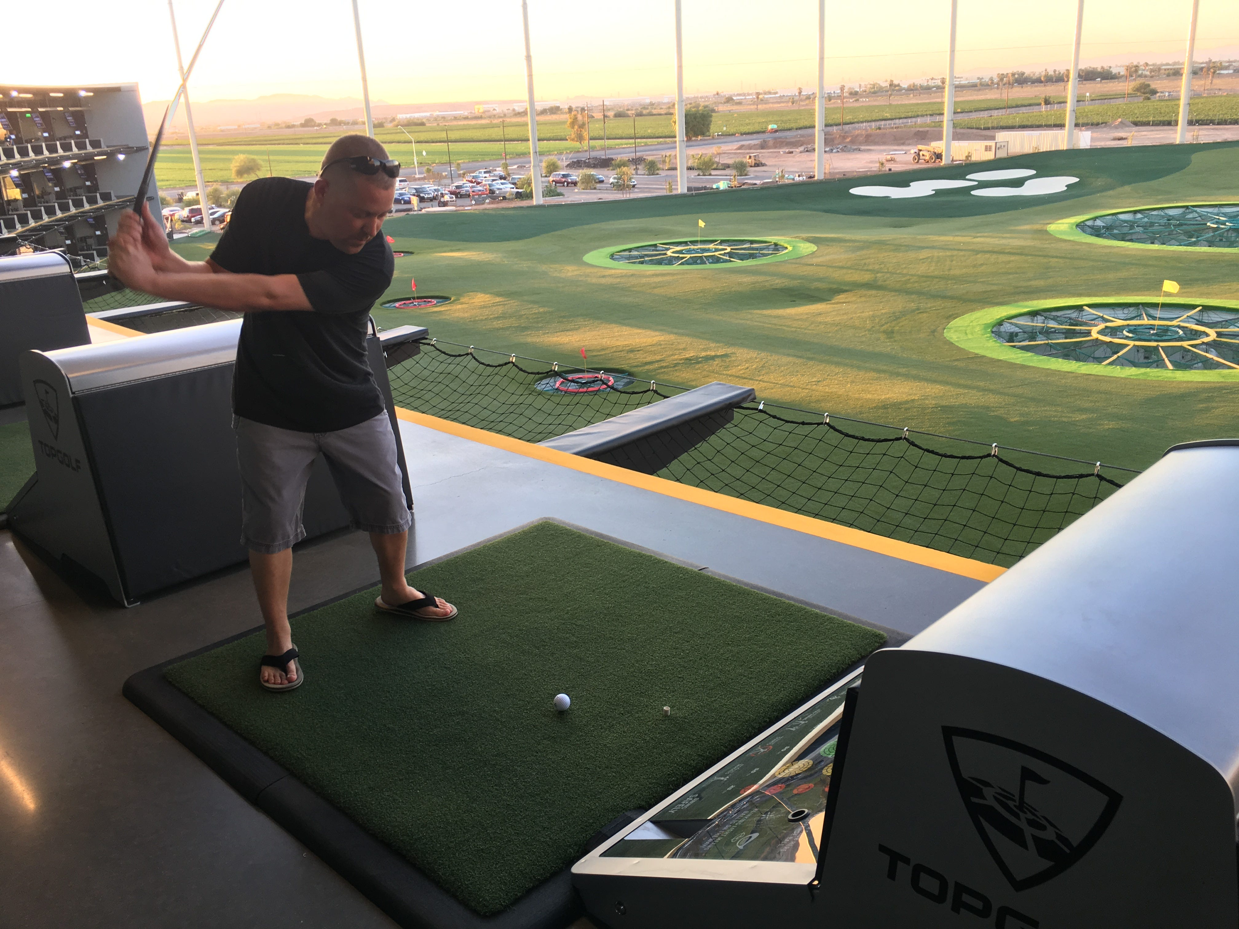 Buckeye resident Casey Stanfield lines up a shot from one of Topgolf Glendale's hitting bays during a tour Sept. 12, 2018, of the newest Valley location near State Farm Stadium. Topgolf Glendale is scheduled to open in September.