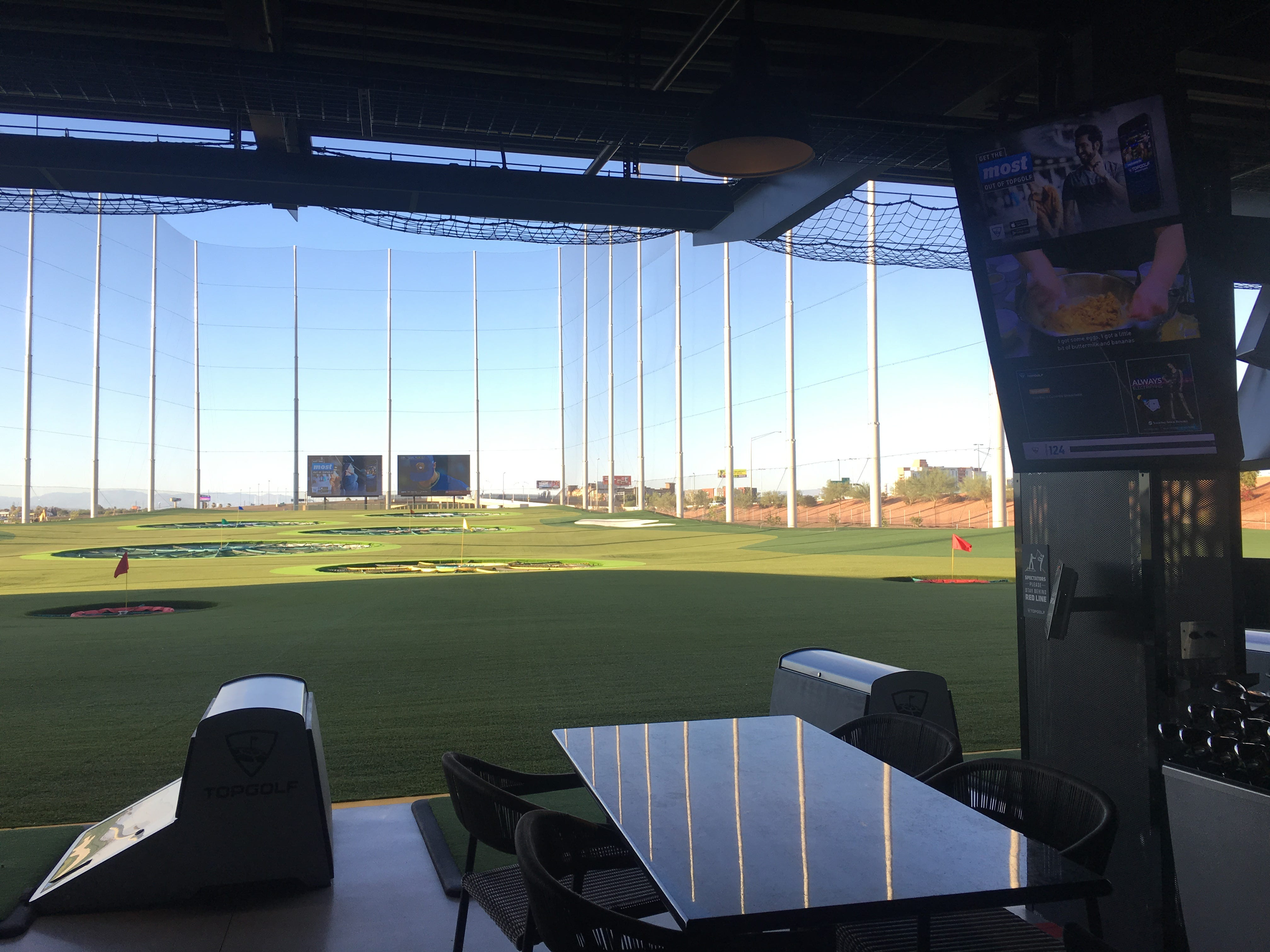 Topgolf Glendale offers more than 100 hitting bays that can each accommodate up to eight people, and groups of six players can compete for points on the venue's driving range.