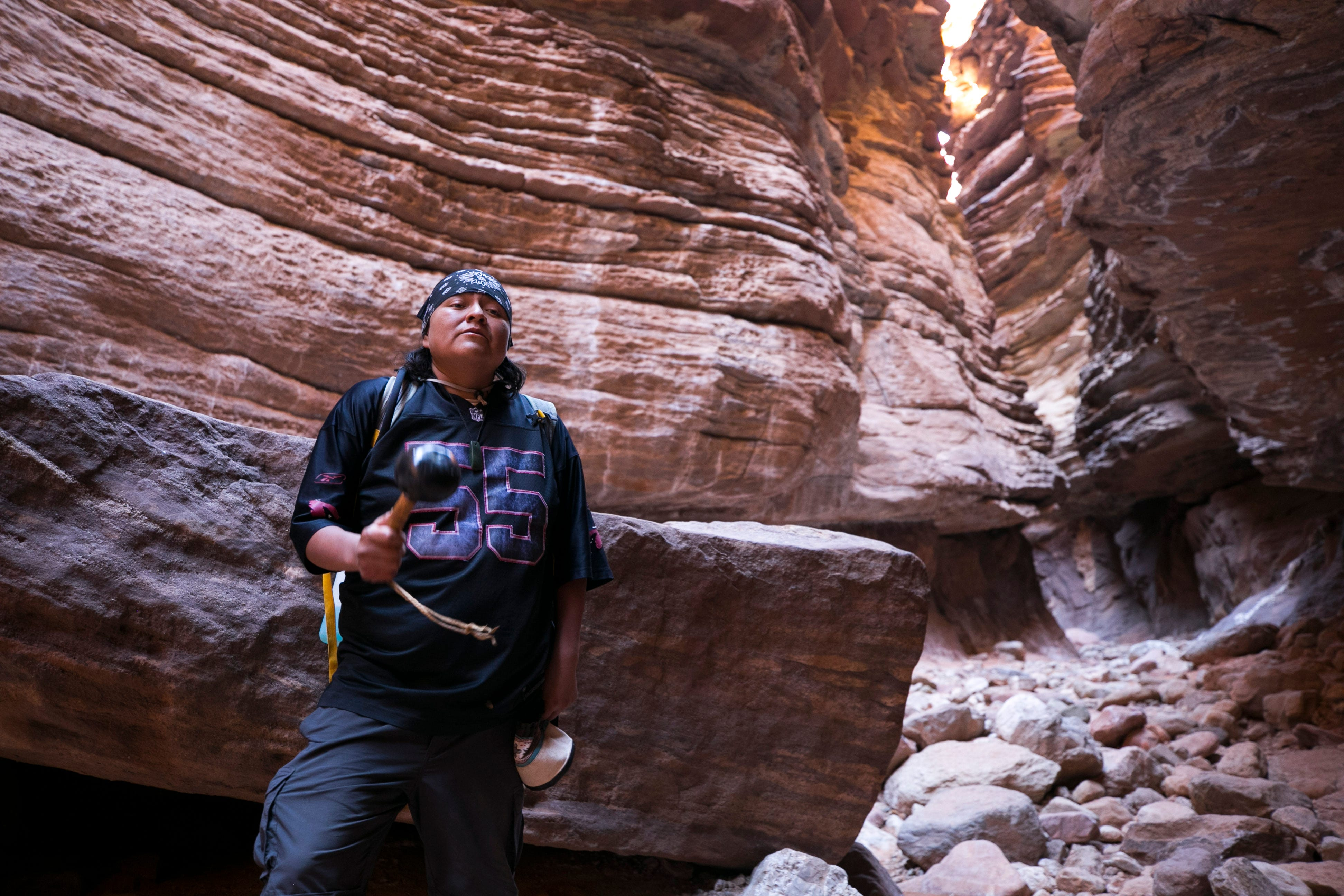 Hualapai tribal member Daniel Powskey sings a native song in Blacktail Canyon, a side canyon drainage of the Colorado River in Grand Canyon National Park. The Hualapai Indians' traditional homeland stretches for over a hundred miles along the Grand Canyon.