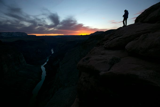 Todd Matin takes in the view of the Colorado River from Toroweap Overlook in Grand Canyon National Park.
