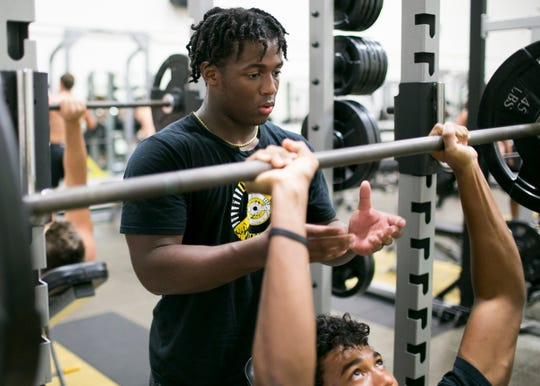 Israel Benjamin, a 17-year-old junior and running back for the Saguaro Sabercats, works out after class at Saguaro High School in Scottsdale on Mon. Aug. 20, 2018.