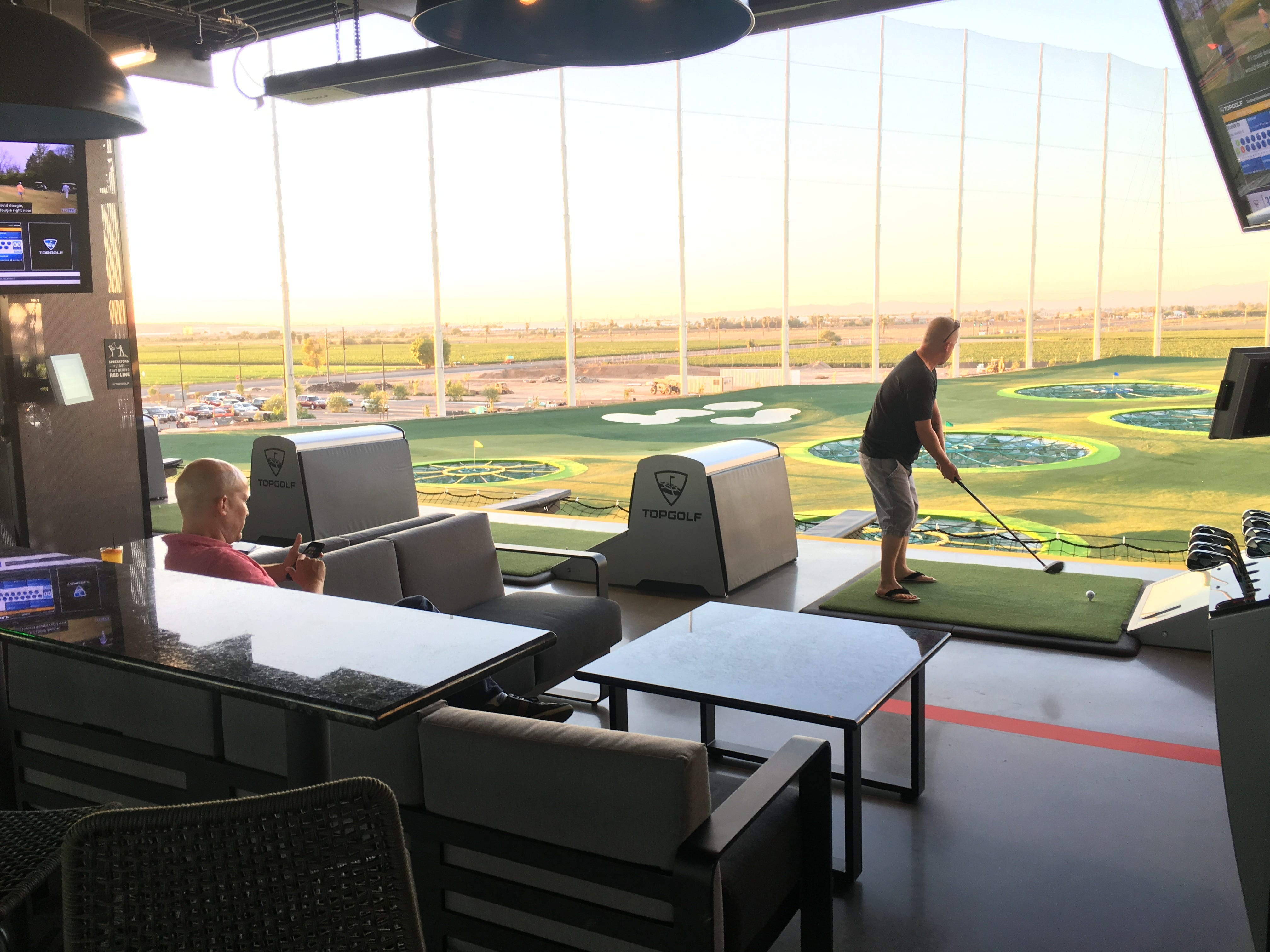 Jonathan Sawyer and Casey Stanfield attend a tour, Sept. 12, 2018, of Topgolf Glendale, the company's newest Valley location, which is scheduled to open near State Farm Stadium in September.