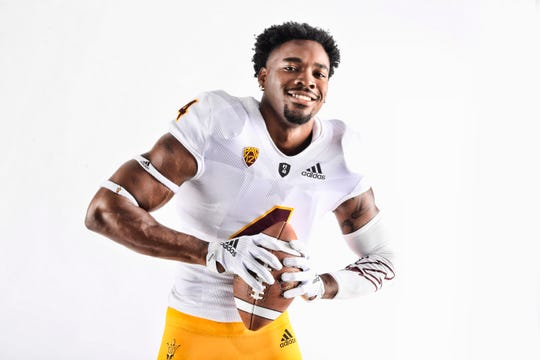 ASU's Koron Crump shows off the road football uniform the Sun Devils will wear at San Diego State on Saturday, Sept. 15, 2018.