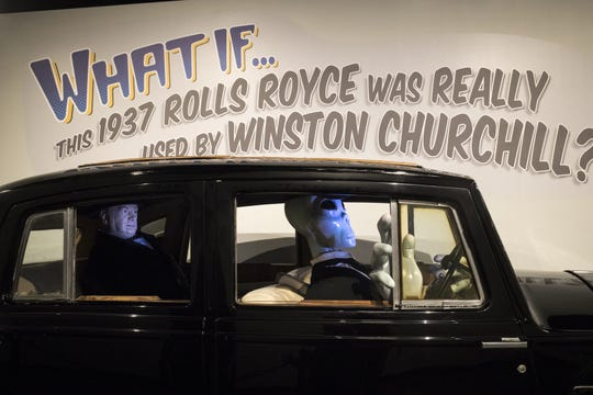 An Alien (right, with the green skin and long fingers) drives Winston Churchill (the clueless gent to the left) in a display, September 11, 2018, in the museum at the Bowlin Travel Center, east of Benson, Arizona.