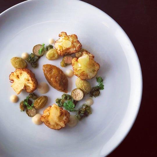 Atlas Bistro's crispy cauliflower florets with ghee-raisin gremolata, one of the dishes avaialble for Fall Arizona Restaurant Week.