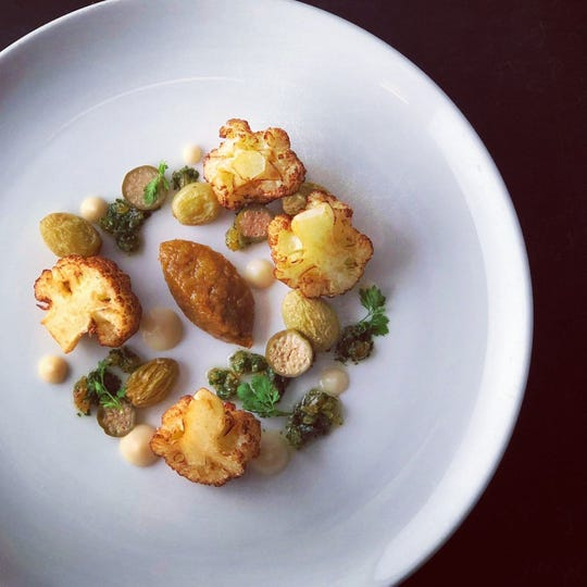 Atlas Bistro's crispy cauliflower florets with ghee-raisin gremolata, one of the dishes avaialble for Fall Arizona Restaurant Week.