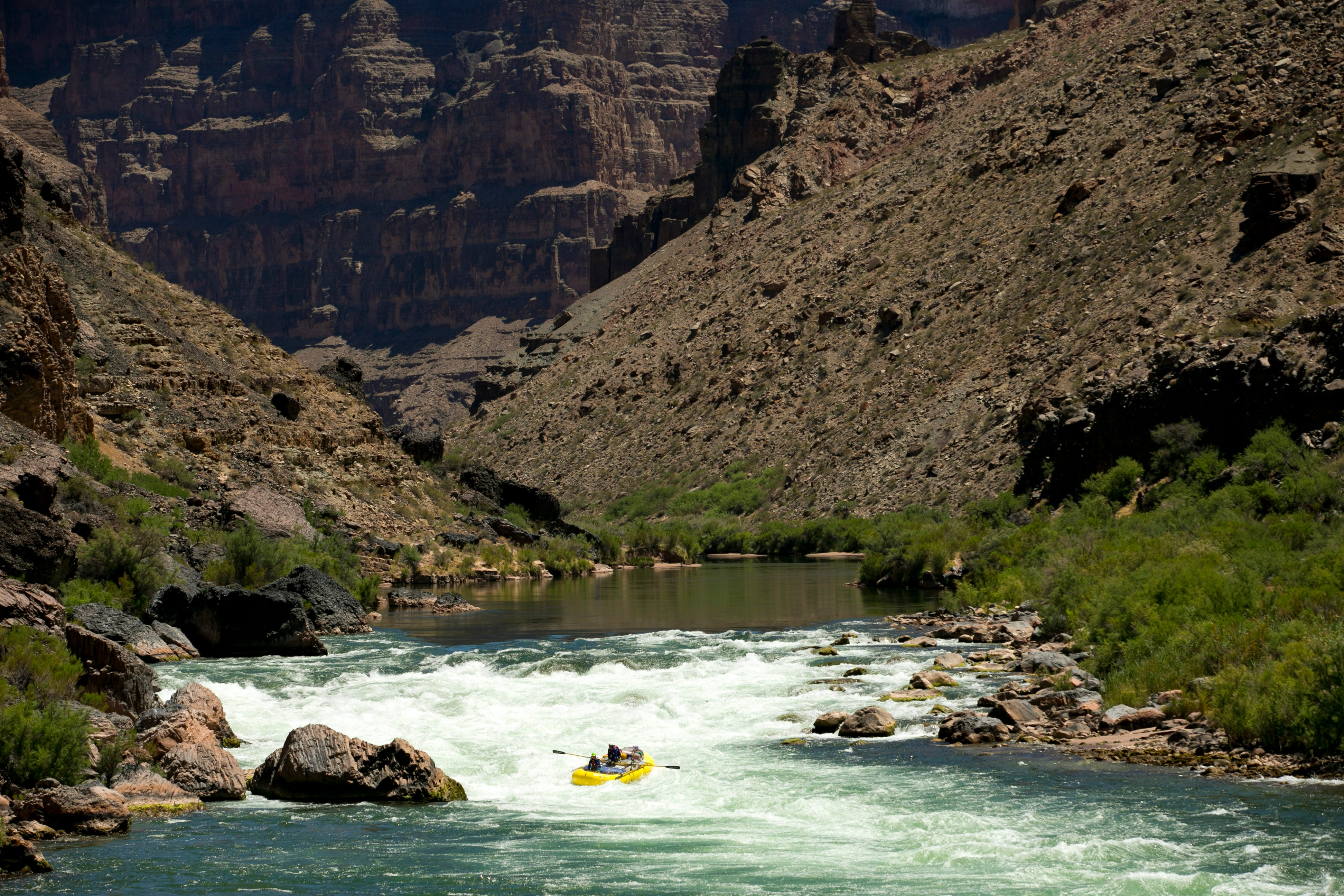 Boaters run the Class 10 Lava Rapid in the Colorado River in Grand Canyon National Park. The Grand Canyon remains a prize for whitewater enthusiasts who love wild places.