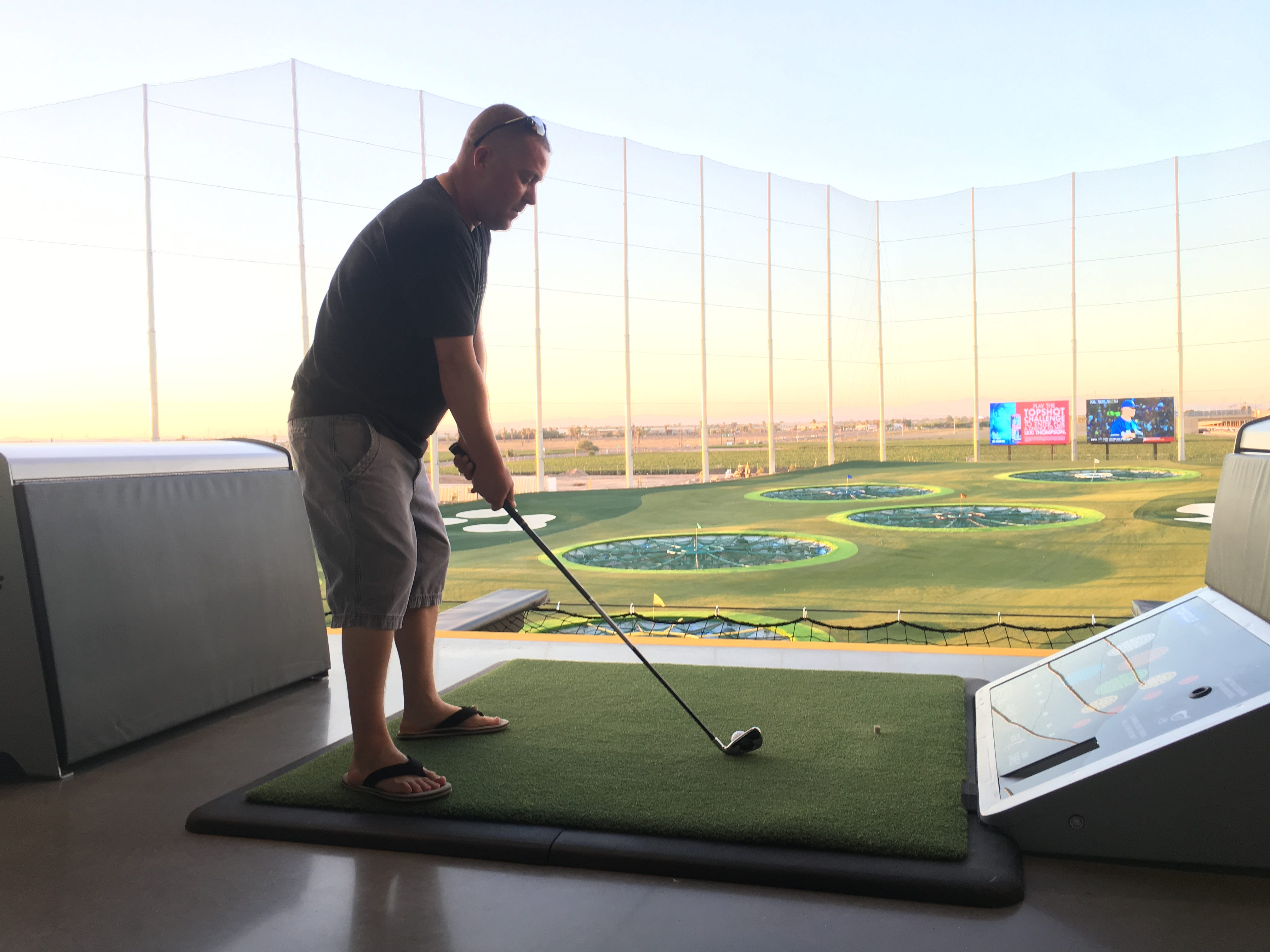 Buckeye resident Casey Stanfield lines up a shot from one of Topgolf Glendale's hitting bays during a tour of the newest Valley location near State Farm Stadium. Topgolf Glendale is scheduled to open in September.
