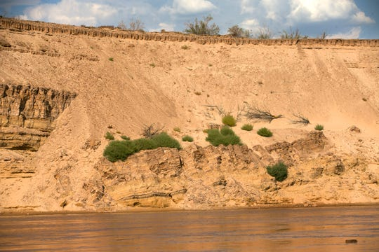 The Colorado River flows past near Pearce Ferry. The flow of the river has declined significantly during the past two decades.