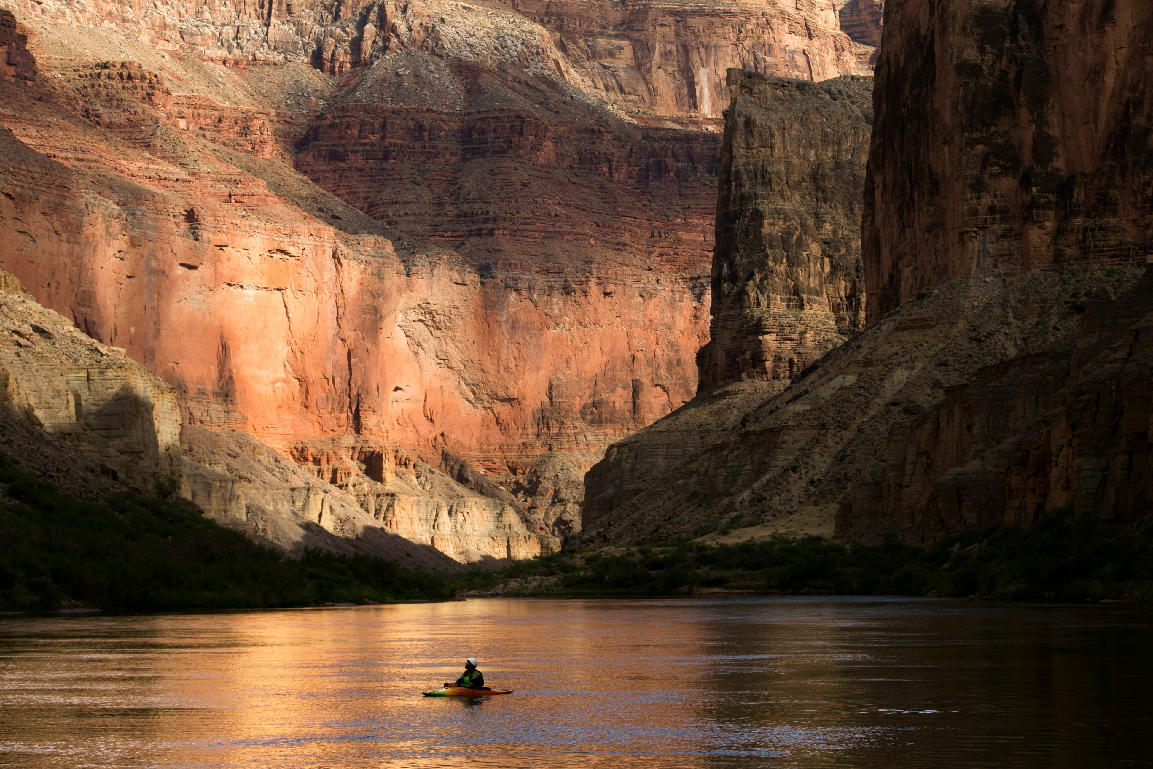Ezra Jones takes in the canyon walls from his kayak on the Colorado River, on May 19, 2018, one of fewer than 30,000 people a year who experience Grand Canyon National Park this way.