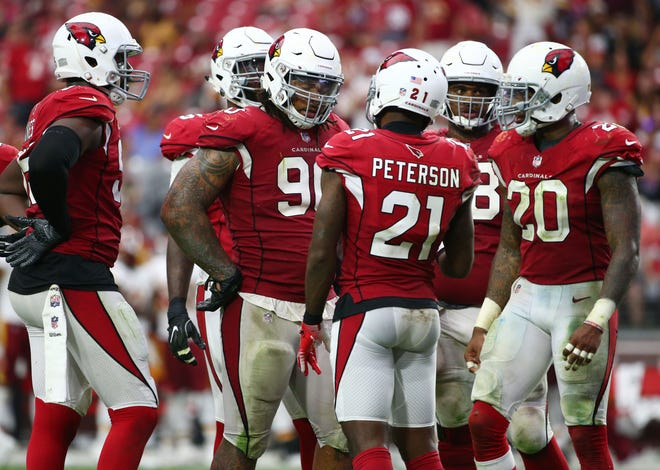 Arizona Cardinals  Patrick Peterson talks to his teammates against the  Washington Redskins in the second half at State Farm Stadium.