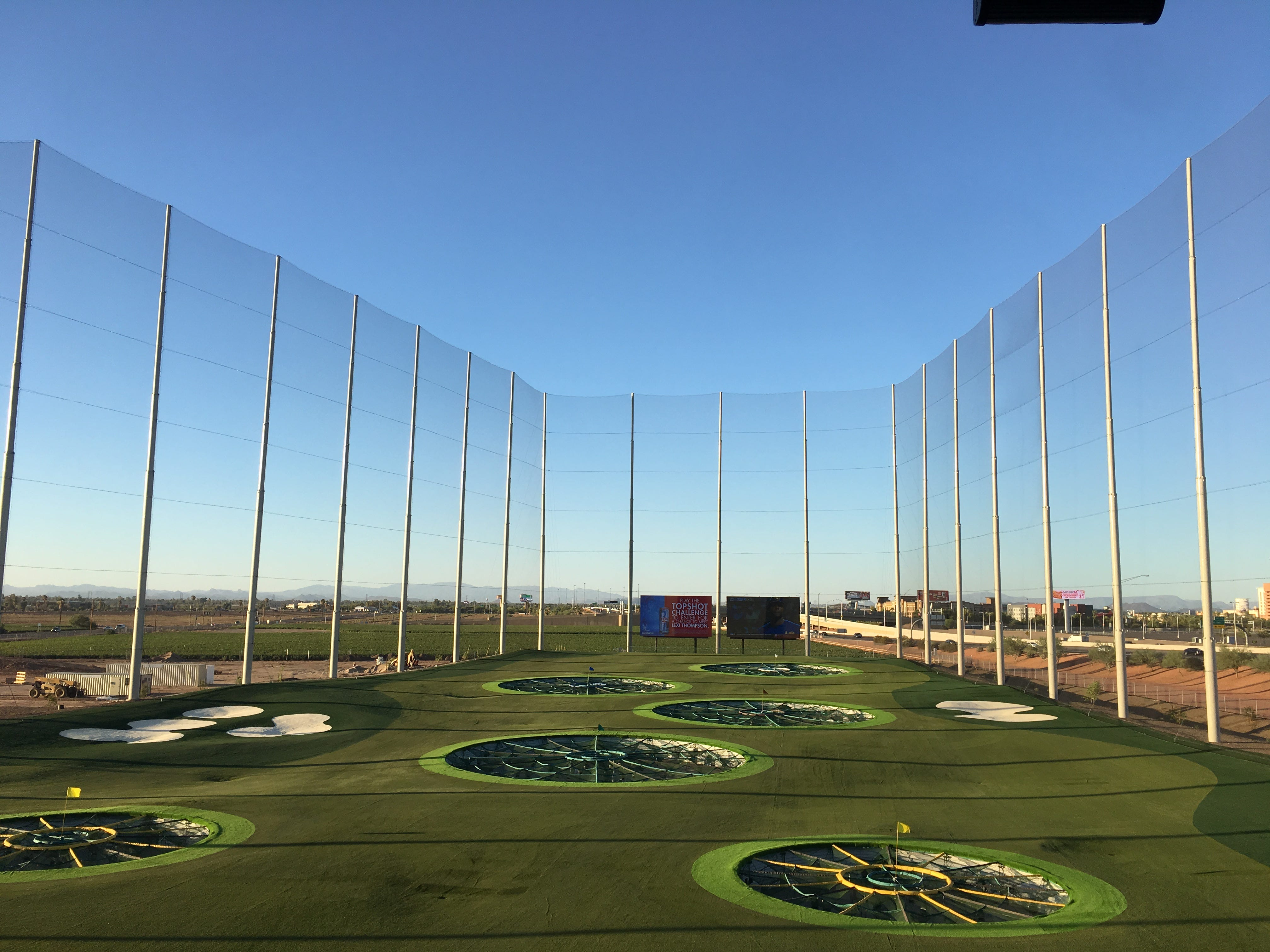 Targets are spread out across Topgolf Glendale's driving range, which features two high-definition TVs at the end of the range.