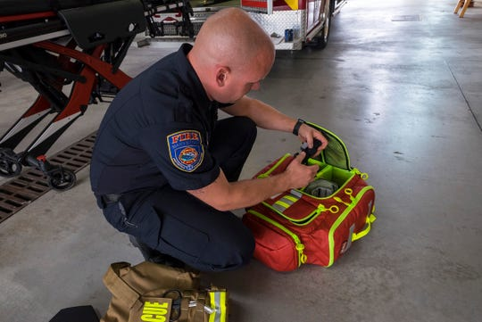 Marysville firefighter paramedic Matt Reeves goes through the contents of a bleeding control kit Thursday, Sept. 13, 2018, at the Marysville Fire Department.