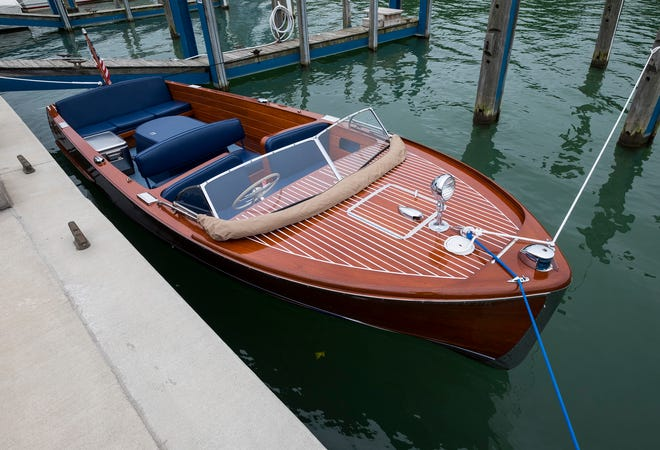 """The 18-foot """"Double Eagle"""" Chris Craft Sea Skiff is docked in a slip at the River Street Marina during Boat the Blue Thursday, Sept. 13, 2018."""
