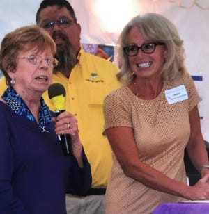 Jane Robinson, left, founder of Kids in Distress Services, Inc., and Robin Hanrahan, board chairwoman, speak at the 2017 open house fundraiser