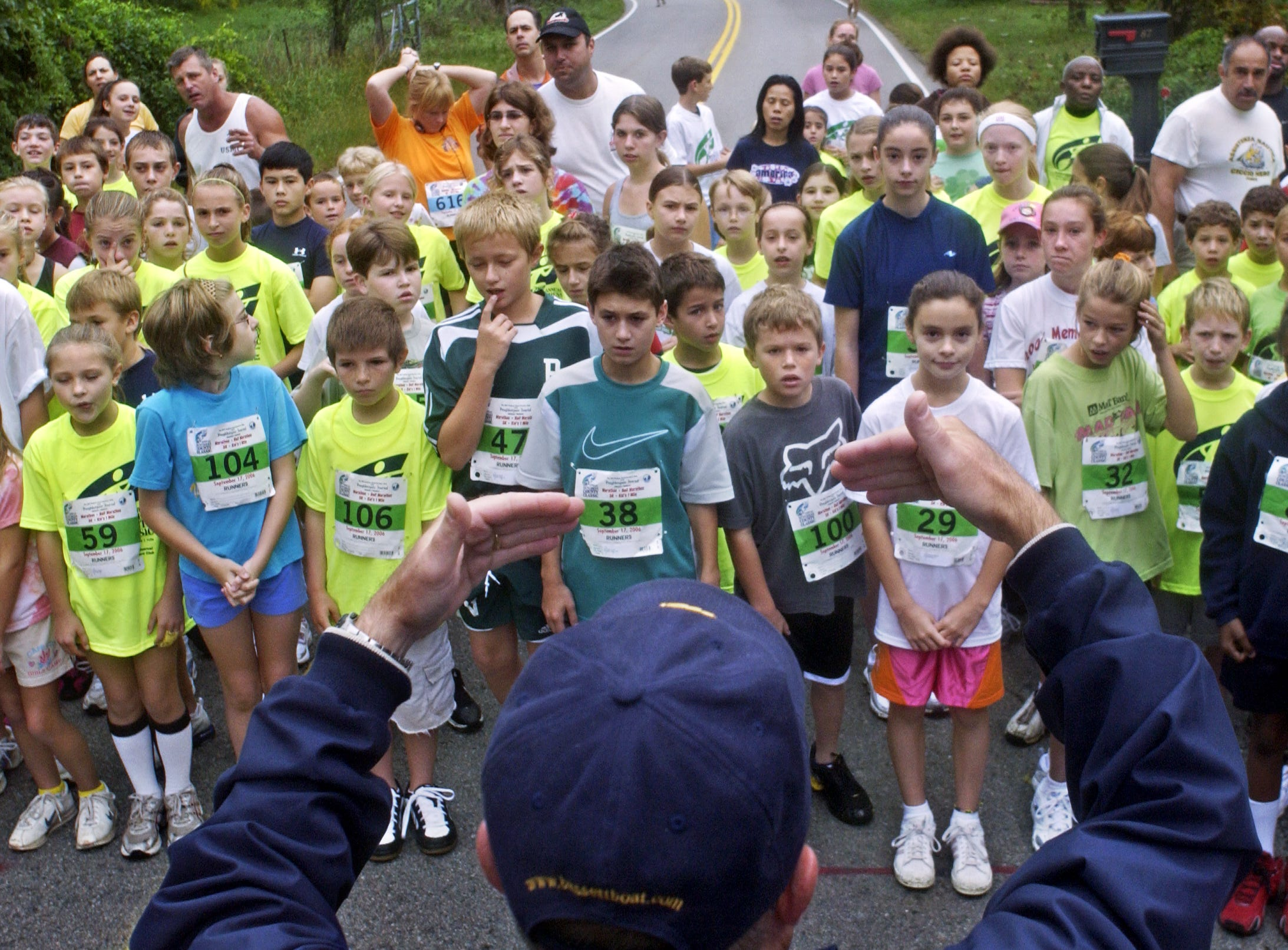 Rich Hansen of Pleasant Valley, facing away from the camera at bottom of frame, gives directions to the kids before the start of the 1-mile kid's race of the Dutchess County Classic road race Sunday, Sept. 17, 2006, at Robinson Lane Recreational Park in Wappinger.