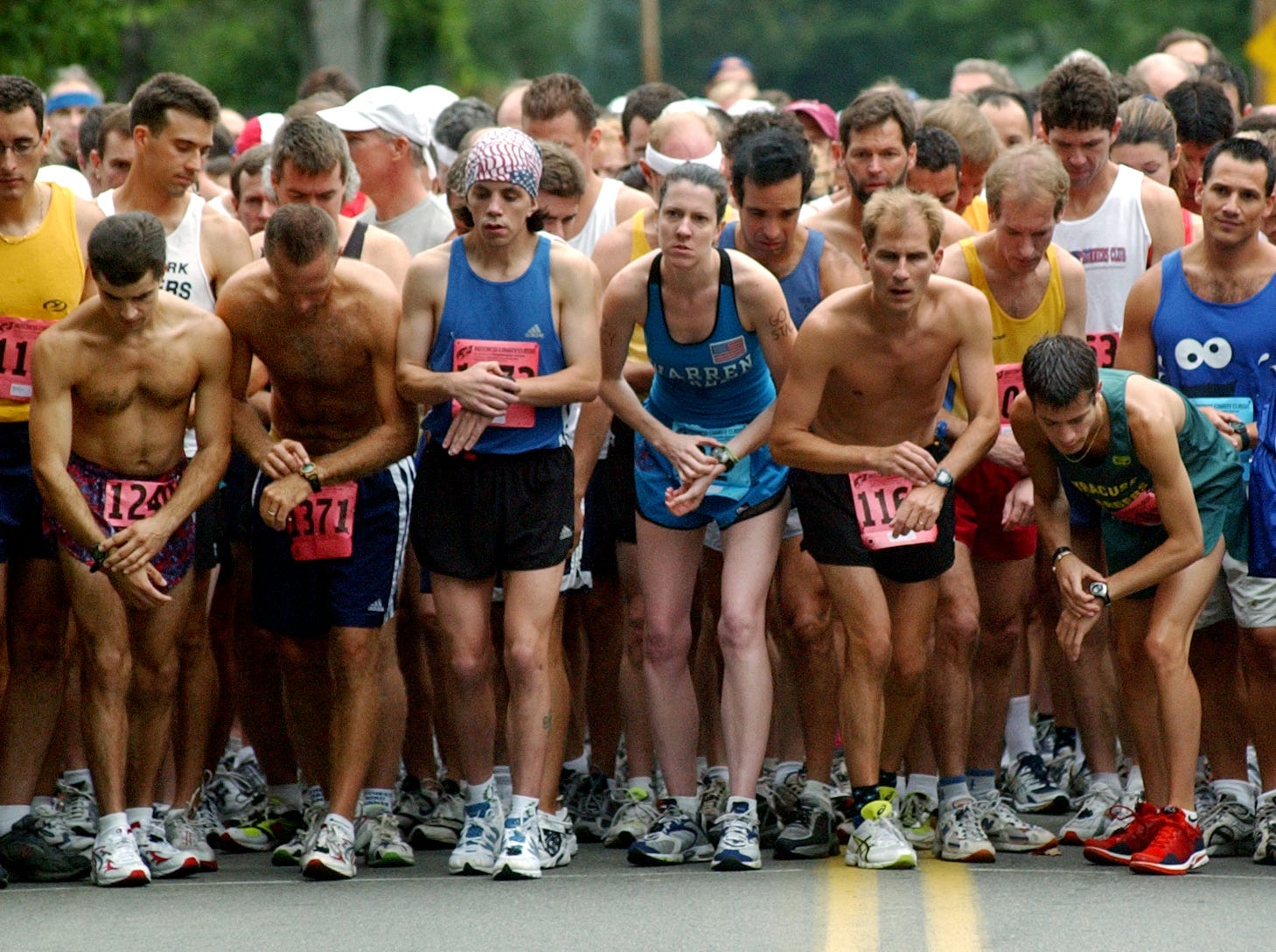 Marathon and half marathon runners start off running on Robinson Lane at the Dutchess County Classic on Sunday, Sept. 15, 2002.