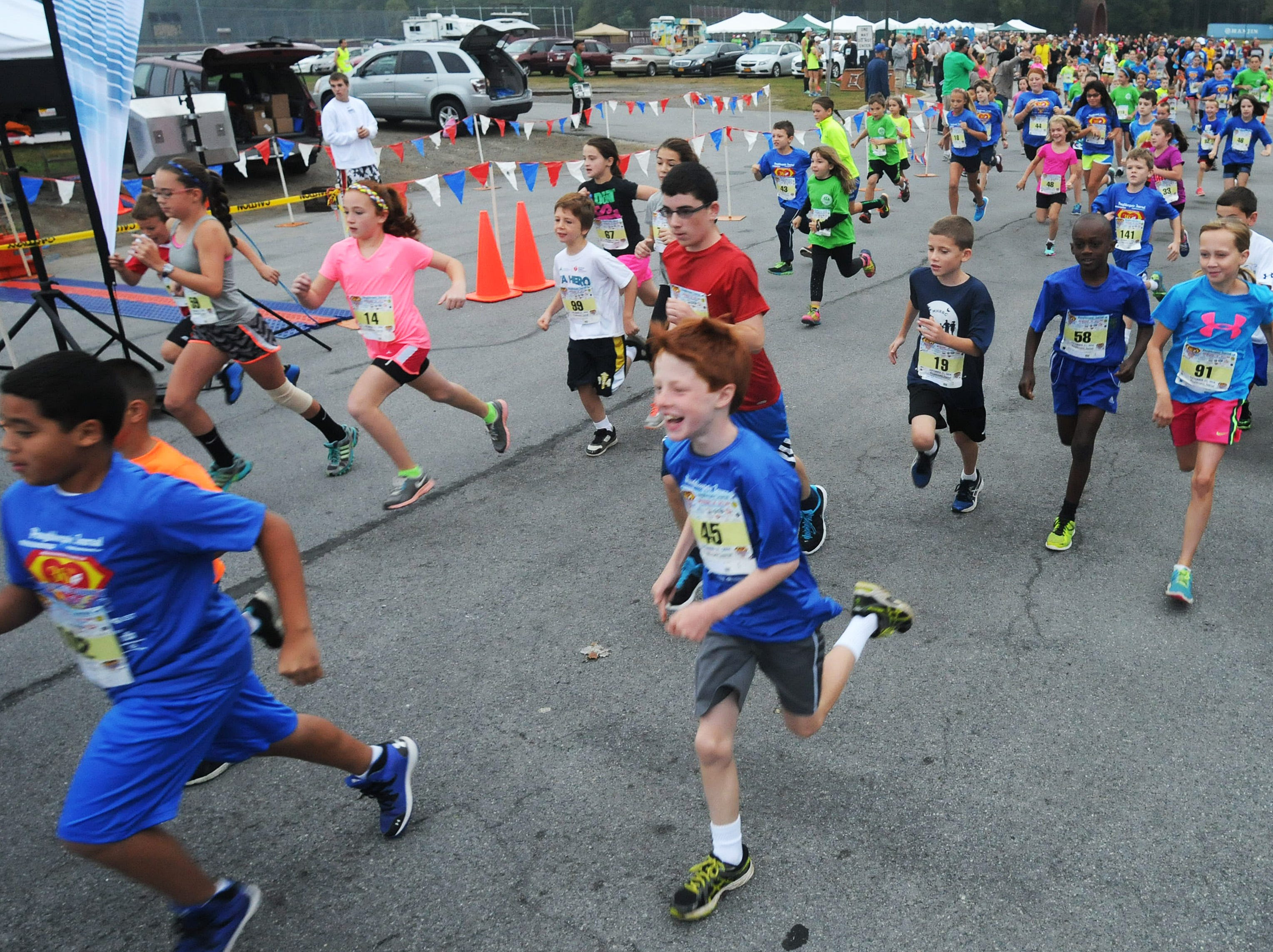 Runners start the Dutchess County Classic 1-mile kids race on Sunday in Freedom Plains. Sept. 21, 2014