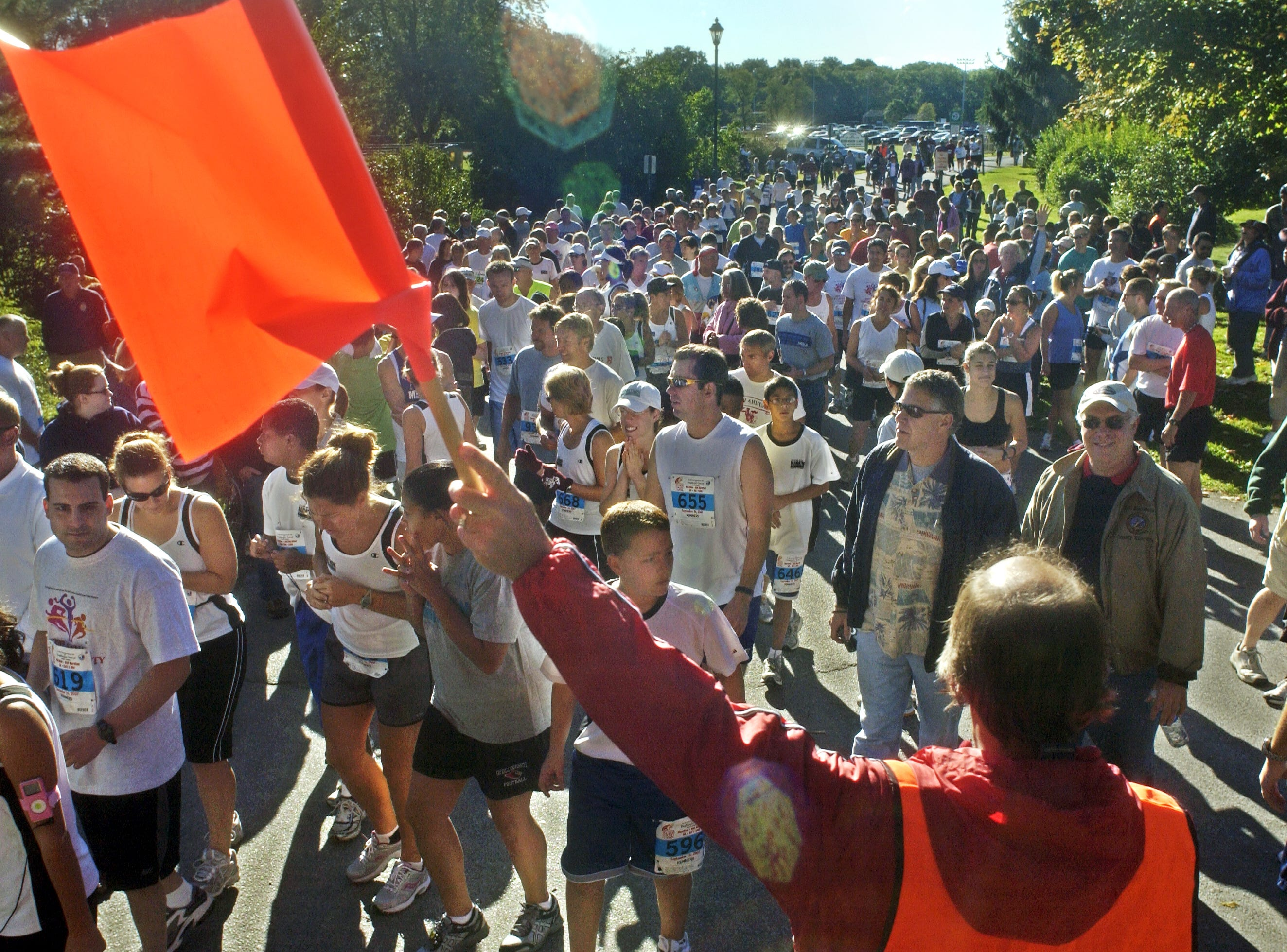 Tony Pignataro of LaGrange directs pedestrians and vehicles with a flag during the 29th annual Dutchess County Classic Sunday, Sept. 16, 2007 in the Town of Wappinger.