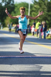 Marisa Sutera-Strange won the 5K women's race during the Dutchess County Classic in LaGrange on Sunday, Sept. 15, 2013.