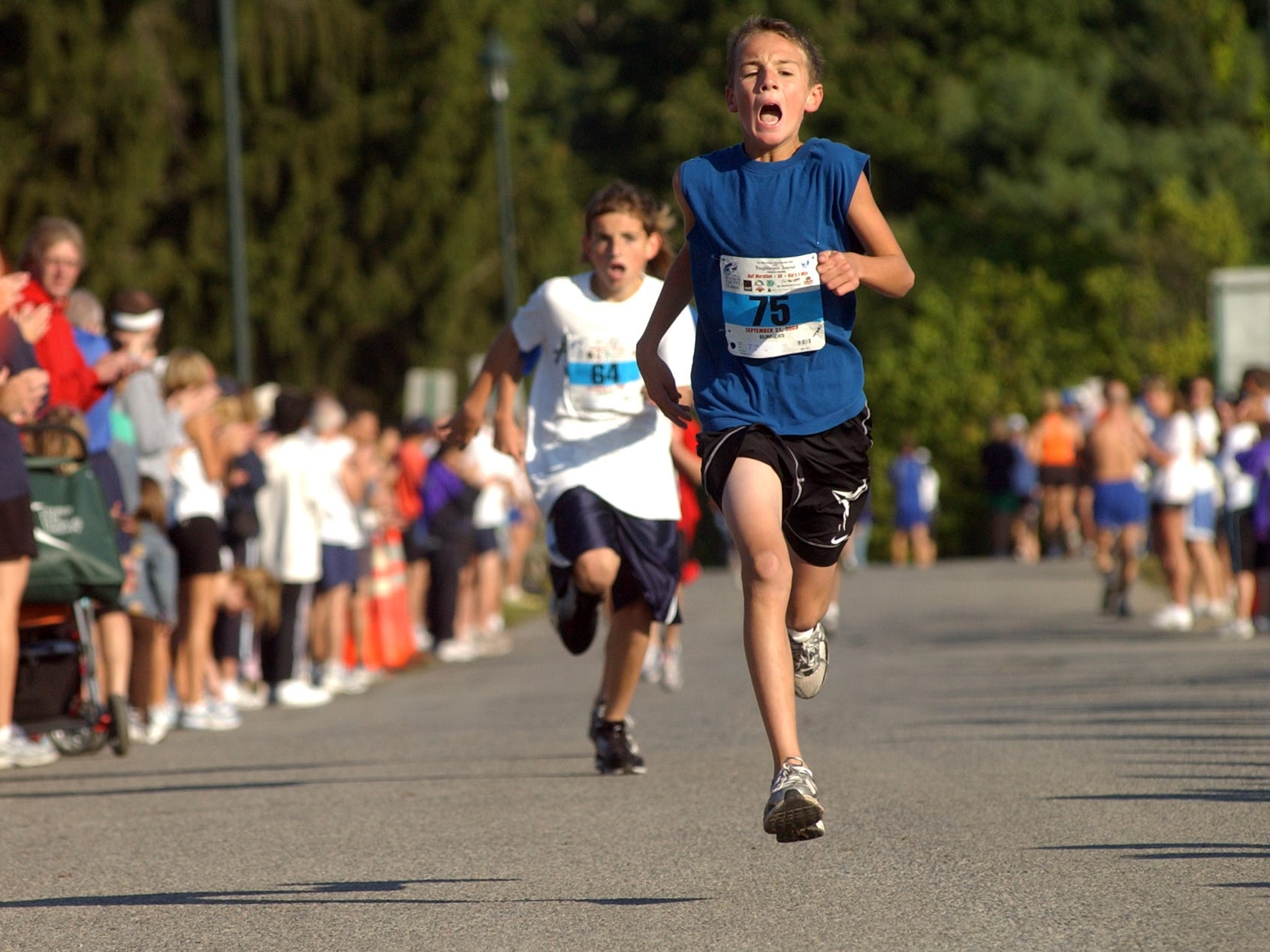 Luke Timm, 10, of the City of Poughkeepsie wins the kids' race of the 30th annual Dutchess County Classic Sunday, Sept. 21, 2008, starting and finishing at the Wappingers Recreation Area in Wappinger.