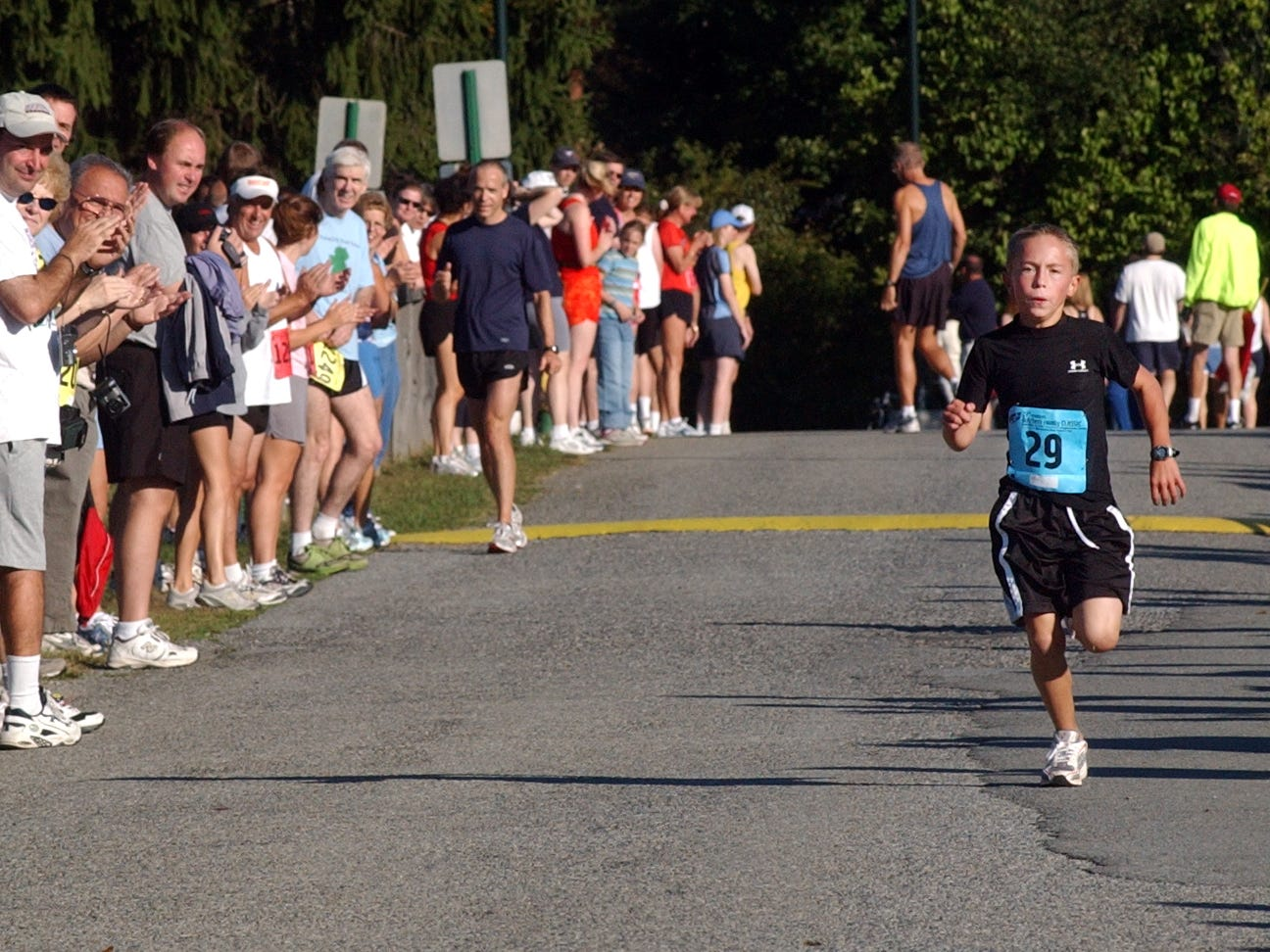 Sebastian Hanson, 10, runs to the finish line to win the kids race at the Dutchess County Classic on Sunday, Sept. 18, 2005.