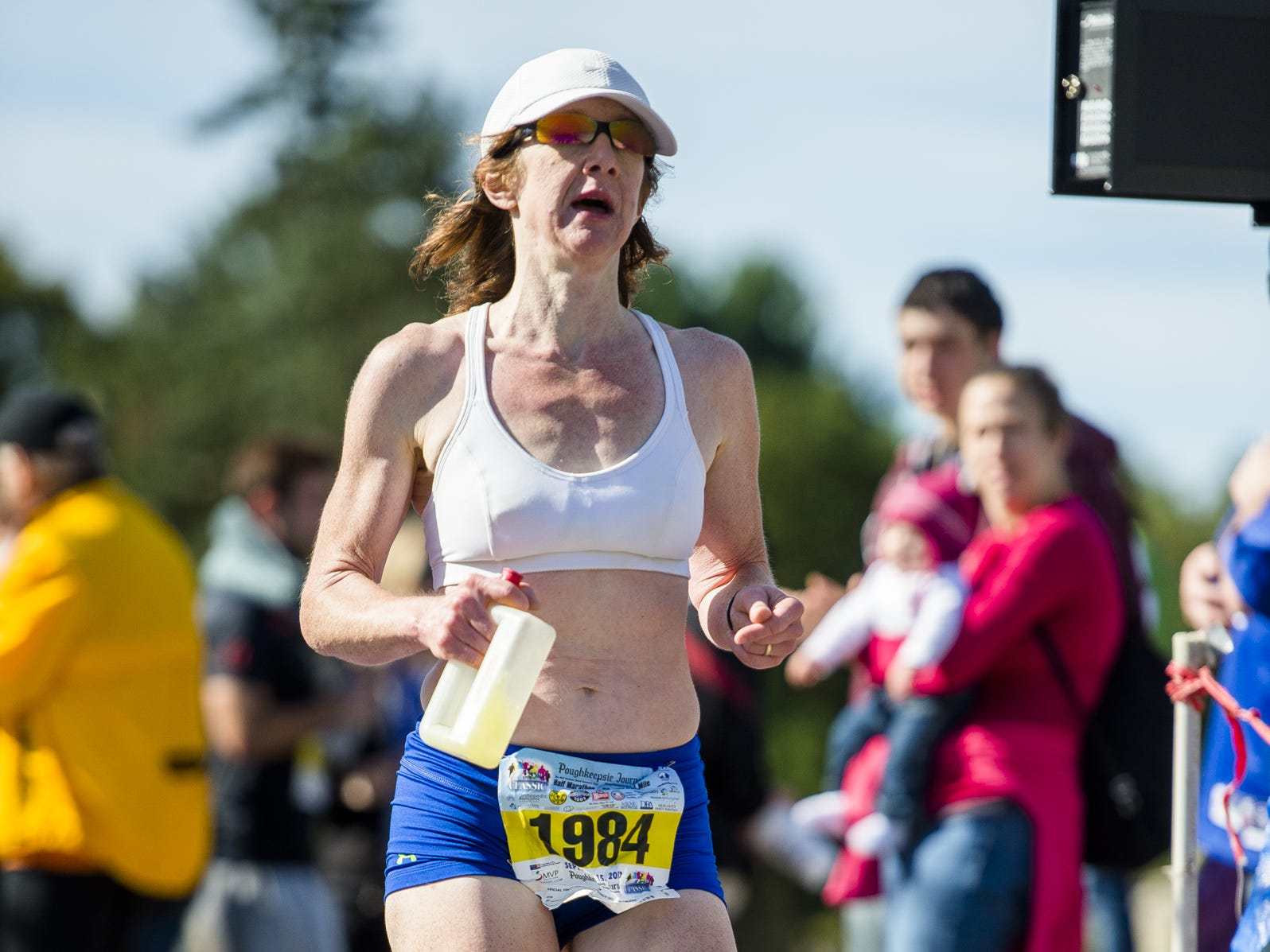 Connie Seigh of Pleasant Valley crosses the finish line after winning the women's half-marathon race during the Dutchess County Classic on Sept. 15, 2013.