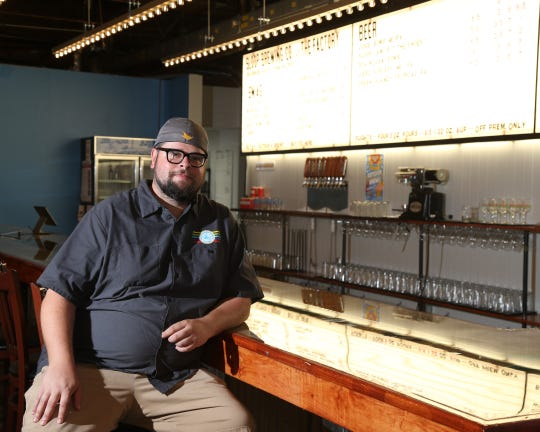 Sloop Brewing's director of sales and marketing Joe Turco sits at the bar at Sloop's new location in East Fishkill on Sept 13, 2018.