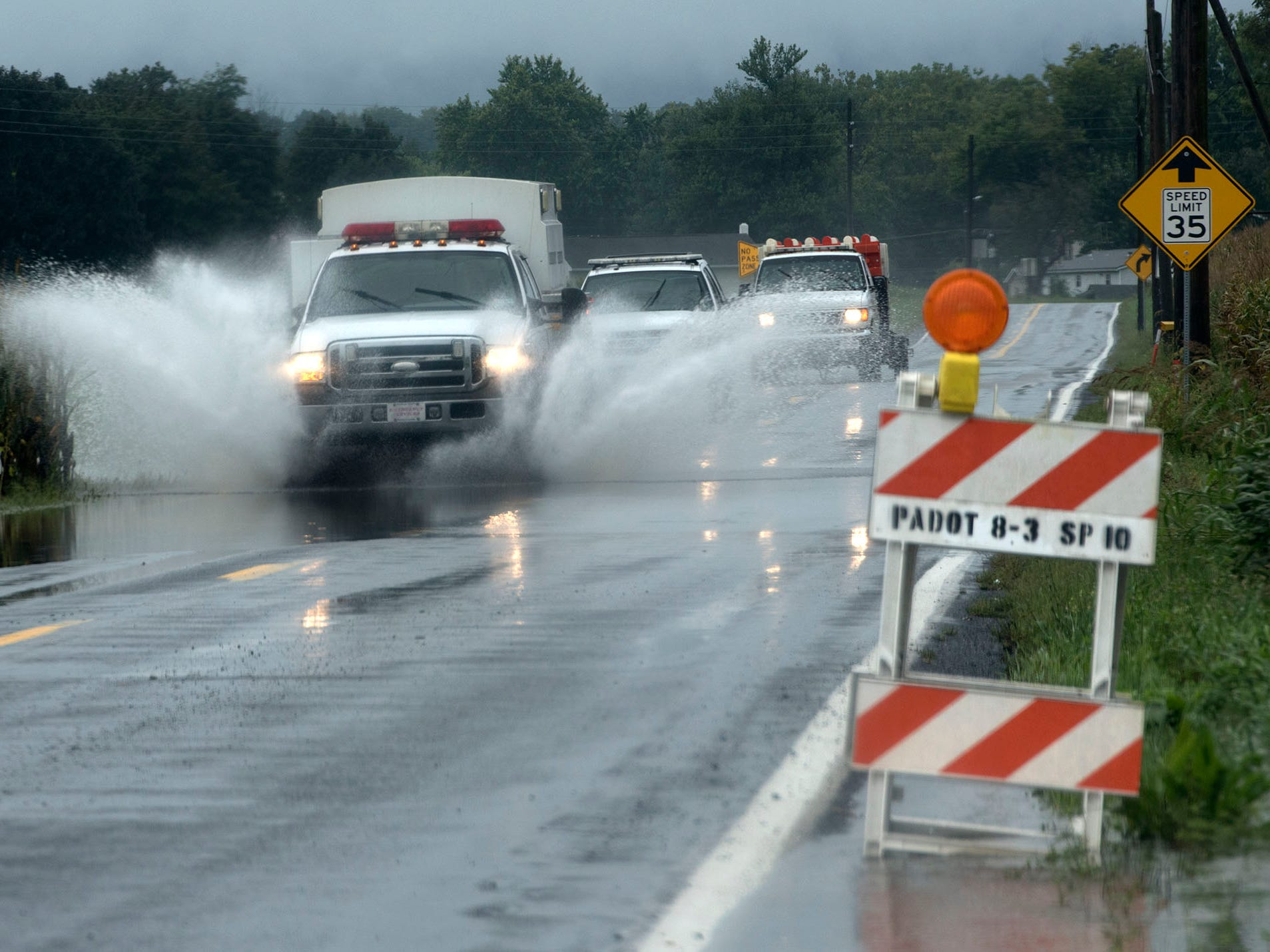 Emergency vehicles travel along Mercersbrug Road during the storm. A bridge was destroyed and there is street flooding and road closings around Shimpstown Road in the Mercersburg area on Thursday, September 13, 2018.