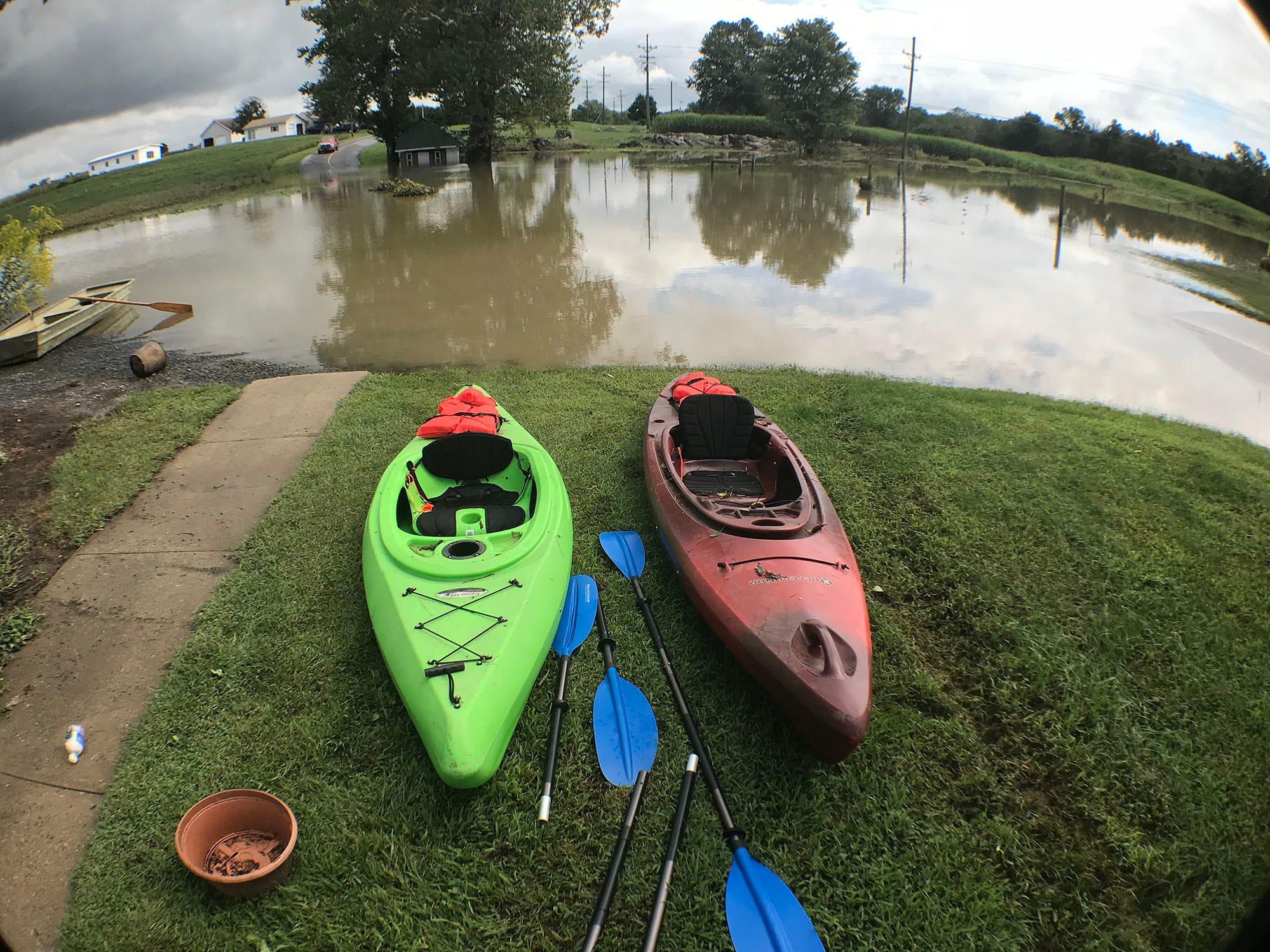 A road just beyond the kayaks pictured is flooded at Shimpstown Road, Mercersburg. A bridge was destroyed and there is street flooding and road closings around Shimpstown Road in the Mercersburg area on Thursday, September 13, 2018.