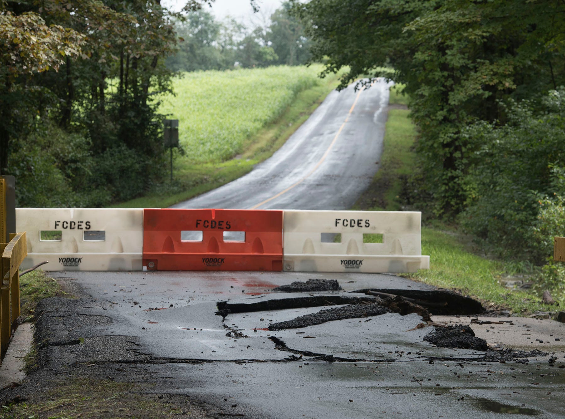 A culvert bridge is damaged after flood waters ripped across it during a storm.  A bridge was destroyed and there is street flooding and road closings around Shimpstown Road in the Mercersburg area on Thursday, September 13, 2018.