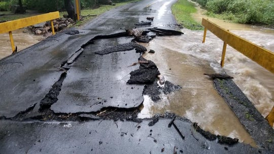 Pavement on a bridge on Shimpstown Road, Montgomery Township, crumbled Thursday, Sept. 13, 2018, due to rushing water.