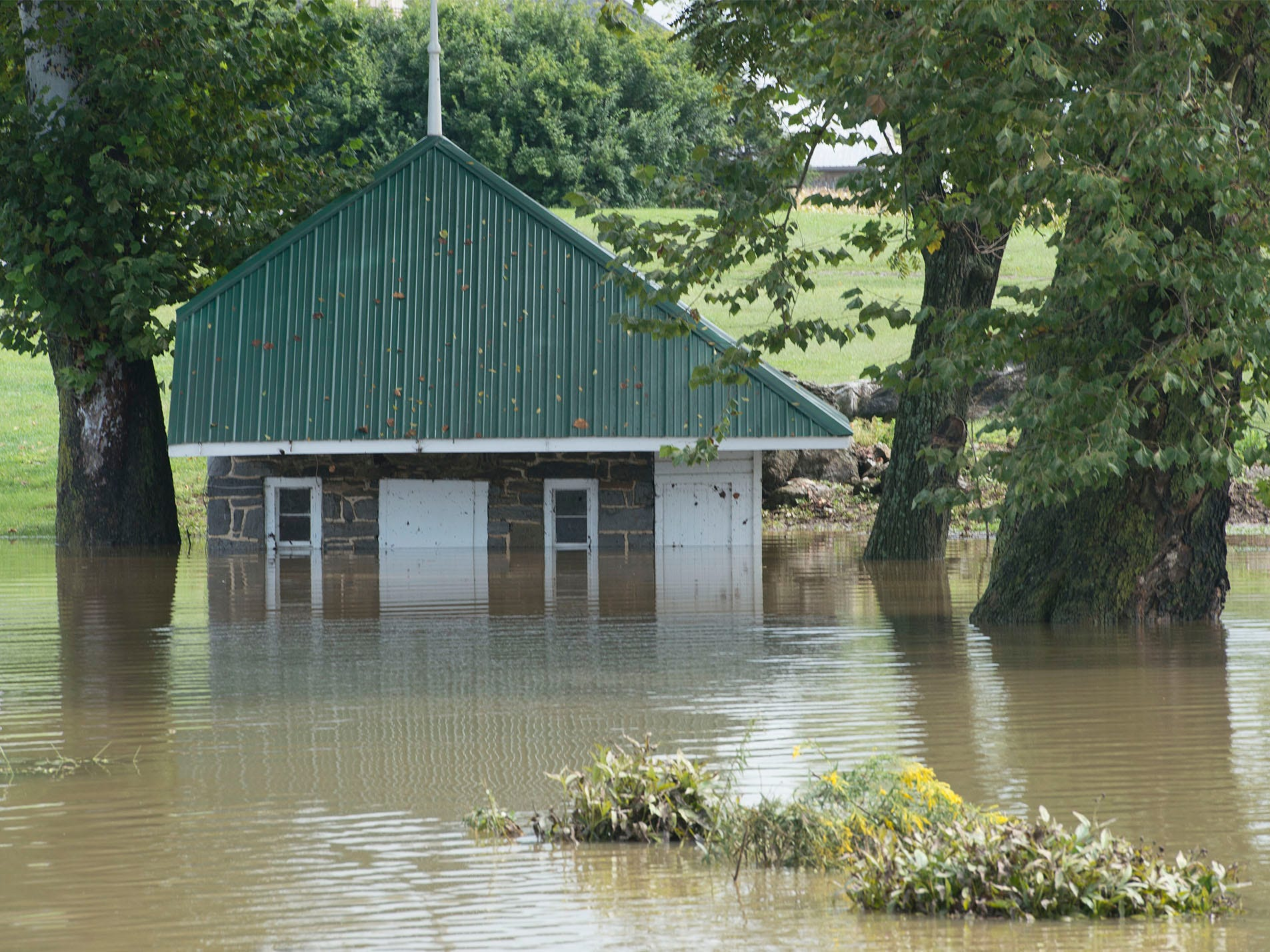 A springhouse is flooded at a farm off Shimpstown Road. A bridge was destroyed and there is street flooding and road closings around Shimpstown Road in the Mercersburg area on Thursday, September 13, 2018.
