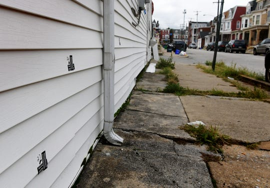 Multiple bullet holes are apparent on a house Thursday, Sept. 13, 2018, in the first block of South Dewey Street in West York where gunfire was reported Wednesday, Sept. 12, 2018. West York Police Chief Matt Millsaps said at least two people were firing guns at each other, and that a number of others were in the area at the time. Bill Kalina photo