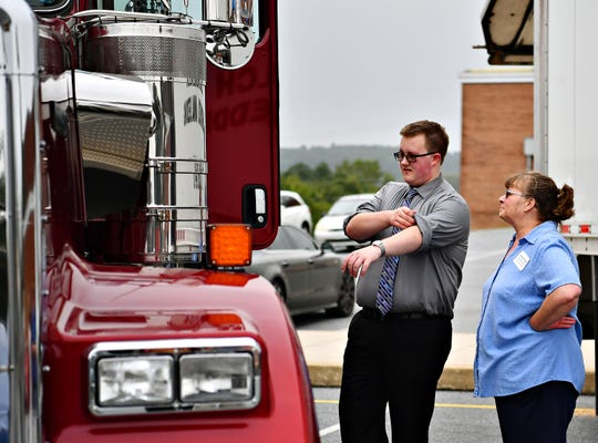 Northeastern junior Larry Hughes, 16, left, and his mother Nancy Hughes, both of Newberry Township, explore commercial vehicles during the launch of the Northeastern High School D.R.I.V.E. (Driving Resources Innovation Vehicular Education) fundraiser at the school in Manchester, Wednesday, Sept. 12, 2018. Hughes is currently in the program, which provides basic CDL license training and networking opportunities for students in commercial driving industry. Dawn J. Sagert photo