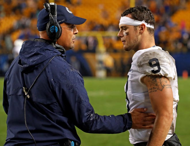 Penn State coach James Franklin, left, talks with quarterback Trace McSorley during the second half of Saturday night's 51-6 win over Pitt. McSorley and Franklin and looking for ways to improve the Nittany Lions' passing game, which has struggled at times over the first two games of the season.  (AP Photo/Gene J. Puskar)