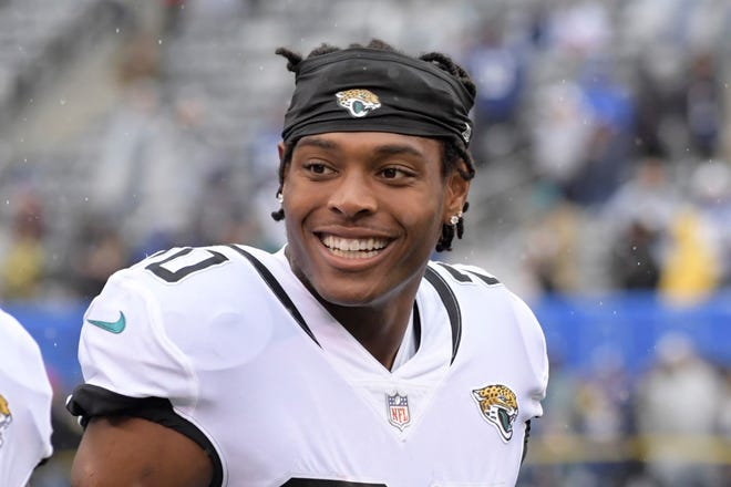 """FILE - In this Sunday, Sept. 9, 2018, file photo, Jacksonville Jaguars cornerback Jalen Ramsey (20) smiles before of an NFL football game against the New York Giants in East Rutherford, N.J. No one is safe from Jalen Ramsey's trash talk. Not even his grandma. The Jaguars star cornerback and one of the NFL's most outspoken personalities said Thursday he """"definitely would"""" hit his grandmother if she lined up against him on the football field. (AP Photo/Bill Kostroun, File)"""